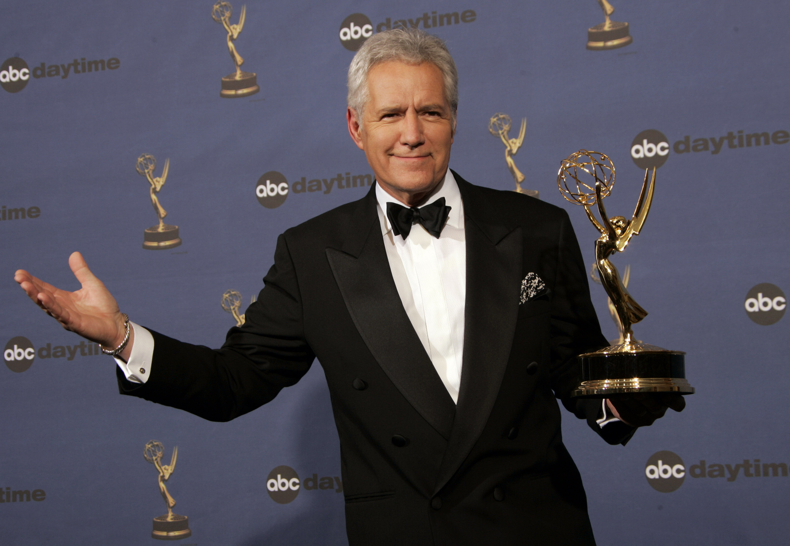 "FILE- In this Friday, April 28, 2006, file photo, Alex Trebek holds the award for outstanding game show host, for his work on ""Jeopardy!"" backstage at the 33rd Annual Daytime Emmy Awards in Los Angeles. (AP Photo/Reed Saxon, File)"