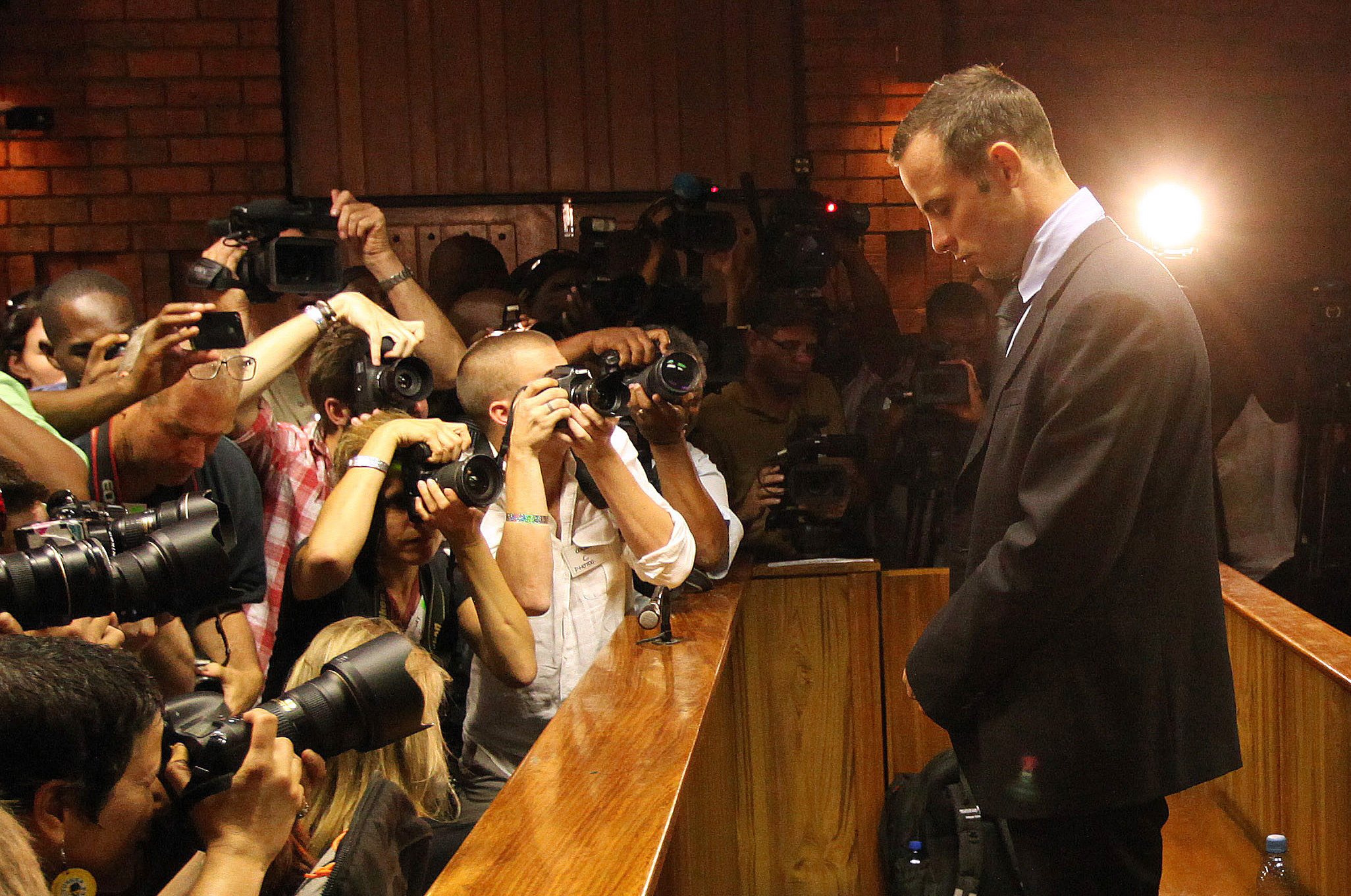 Oscar Pistorius stands in the dock during his bail hearing. (AP)