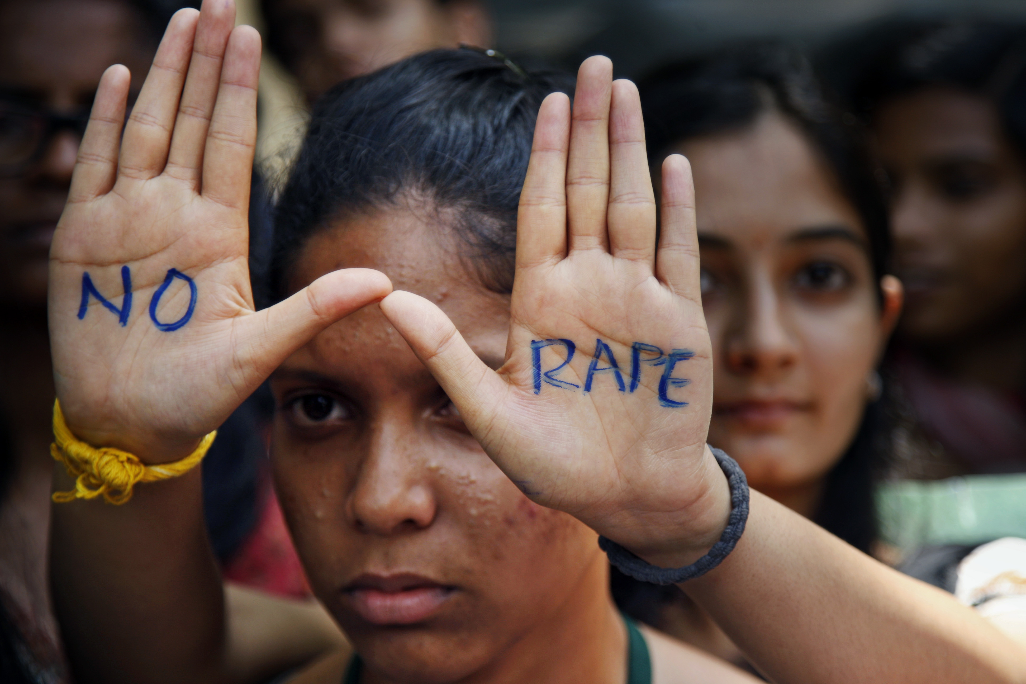 "An Indian student displays ""NO RAPE"" message painted on her hands during a demonstration to demand death sentence for four men convicted of rape and murder of a student on a moving bus in New Delhi bus last year, in Hyderabad, India, Friday, Sept. 13, 2013. A judge on Friday ordered all four to the gallows for a brutal attack that left the young woman with such severe internal injuries that she died two weeks later. (AP Photo/Mahesh Kumar A.)"