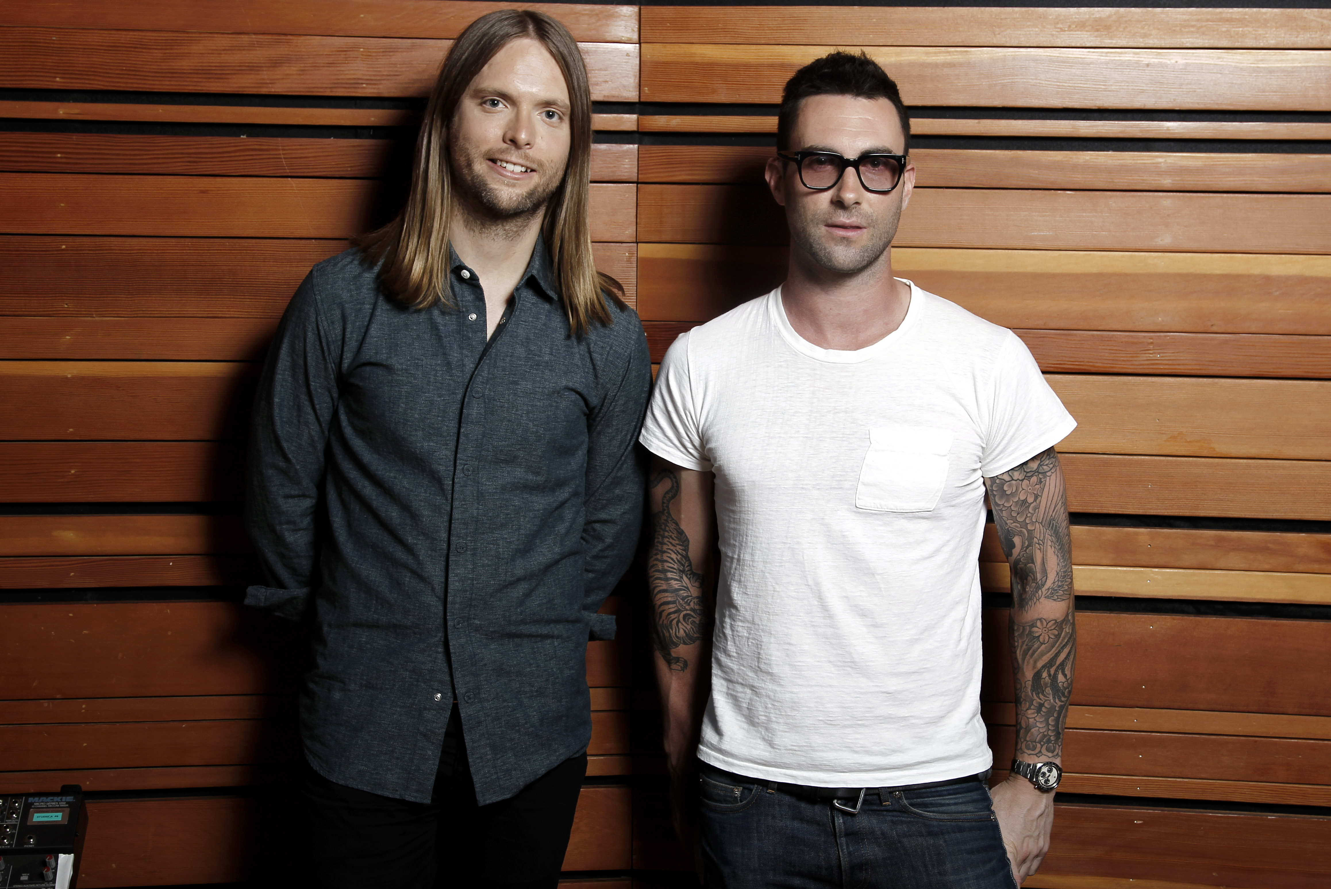 This May 22, 2012 photo shows Adam Levine, right, and James Valentine of the band Maroon 5, posing for a portrait in Los Angeles. The latest release by Maroon 5,