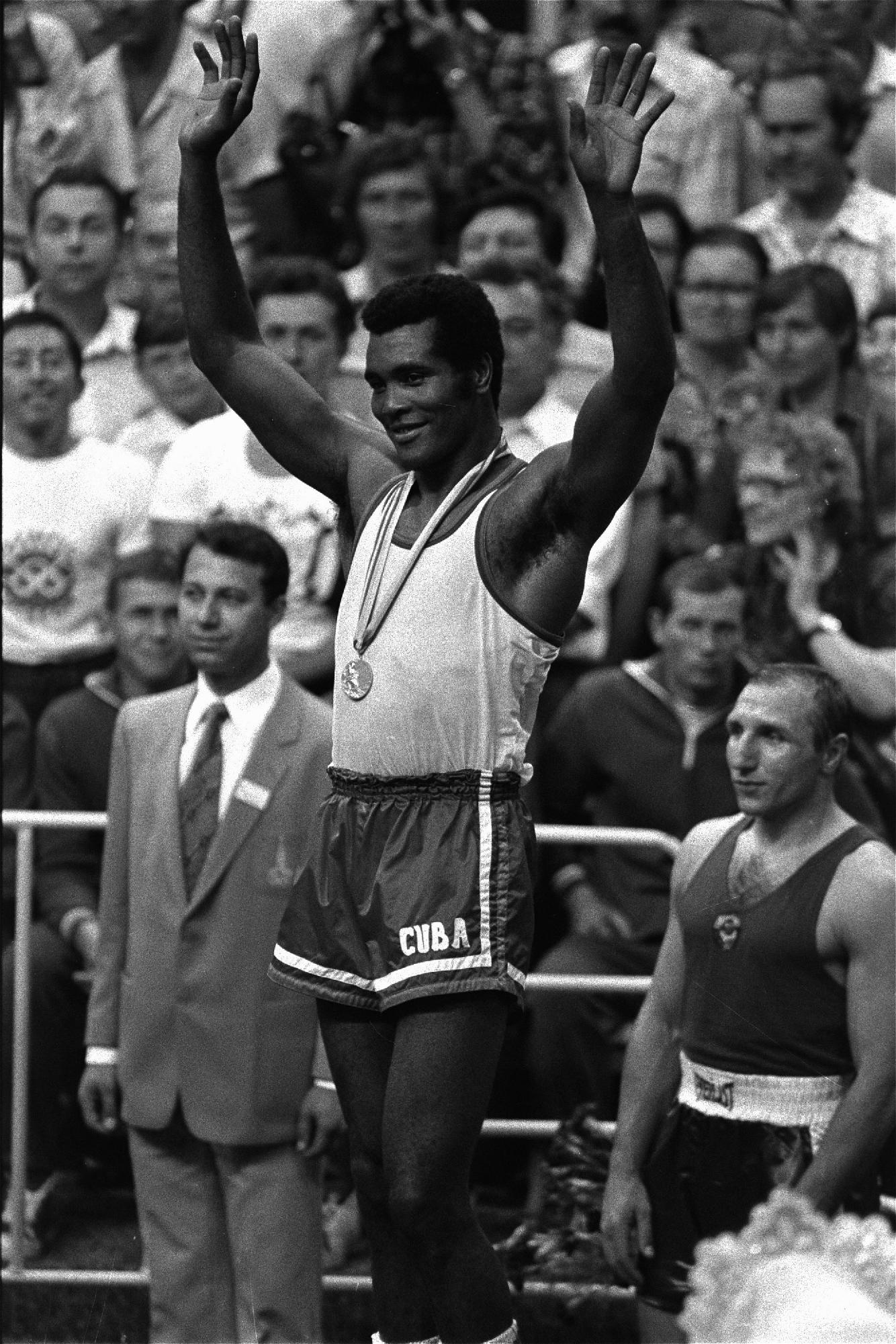 FILE - In this Aug. 2, 1980, file photo, after winning his third Olympic heavyweight championship gold medal, Cuba's Teofilo Stevenson waves to the crowd at the Moscow Olympic Games. Stevenson died on Monday, June 11, 2012, at the age of 60. (AP Photo, file)