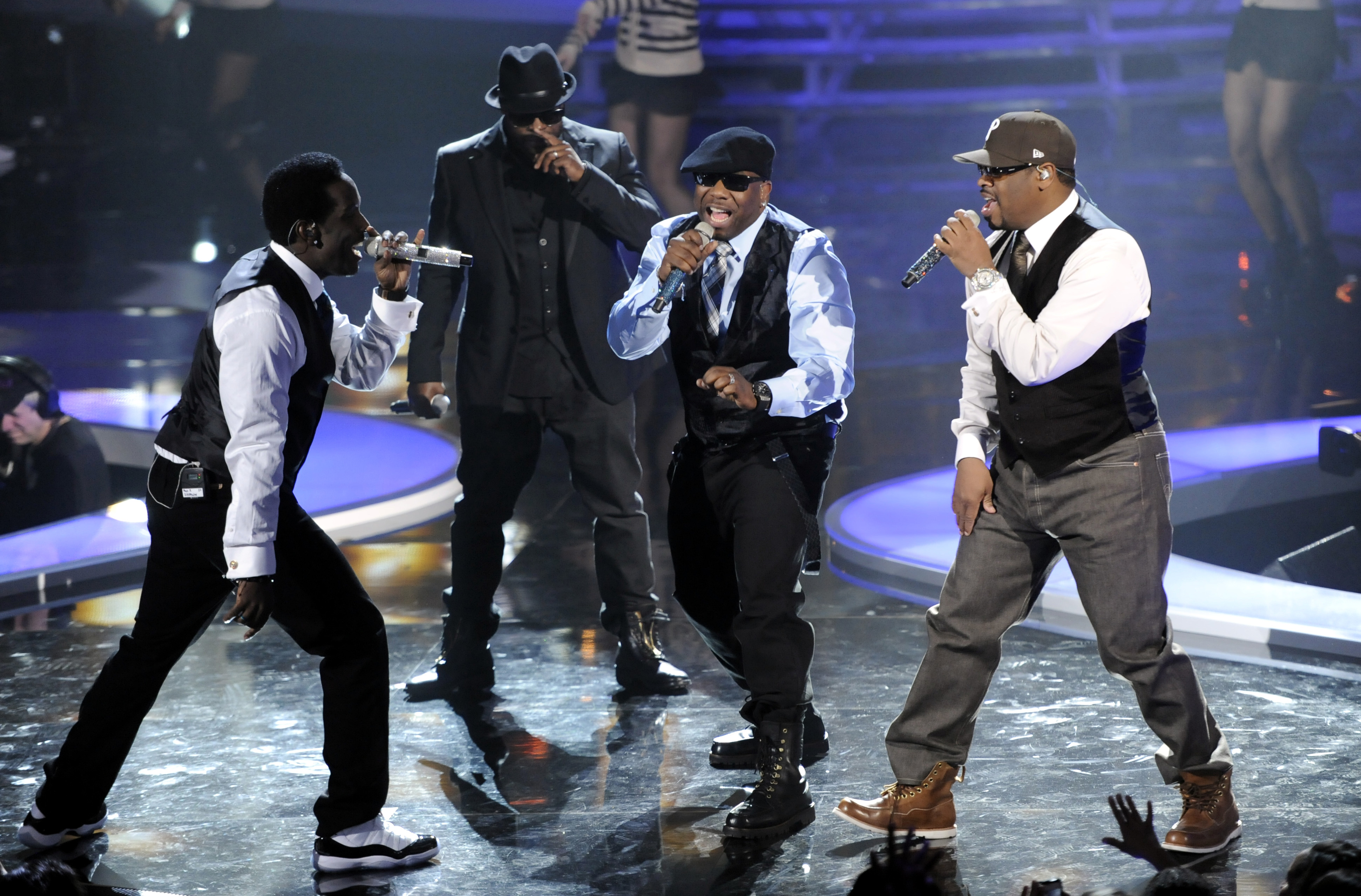 Boyz II Men and Black Thought, of The Roots, second from left, perform onstage at