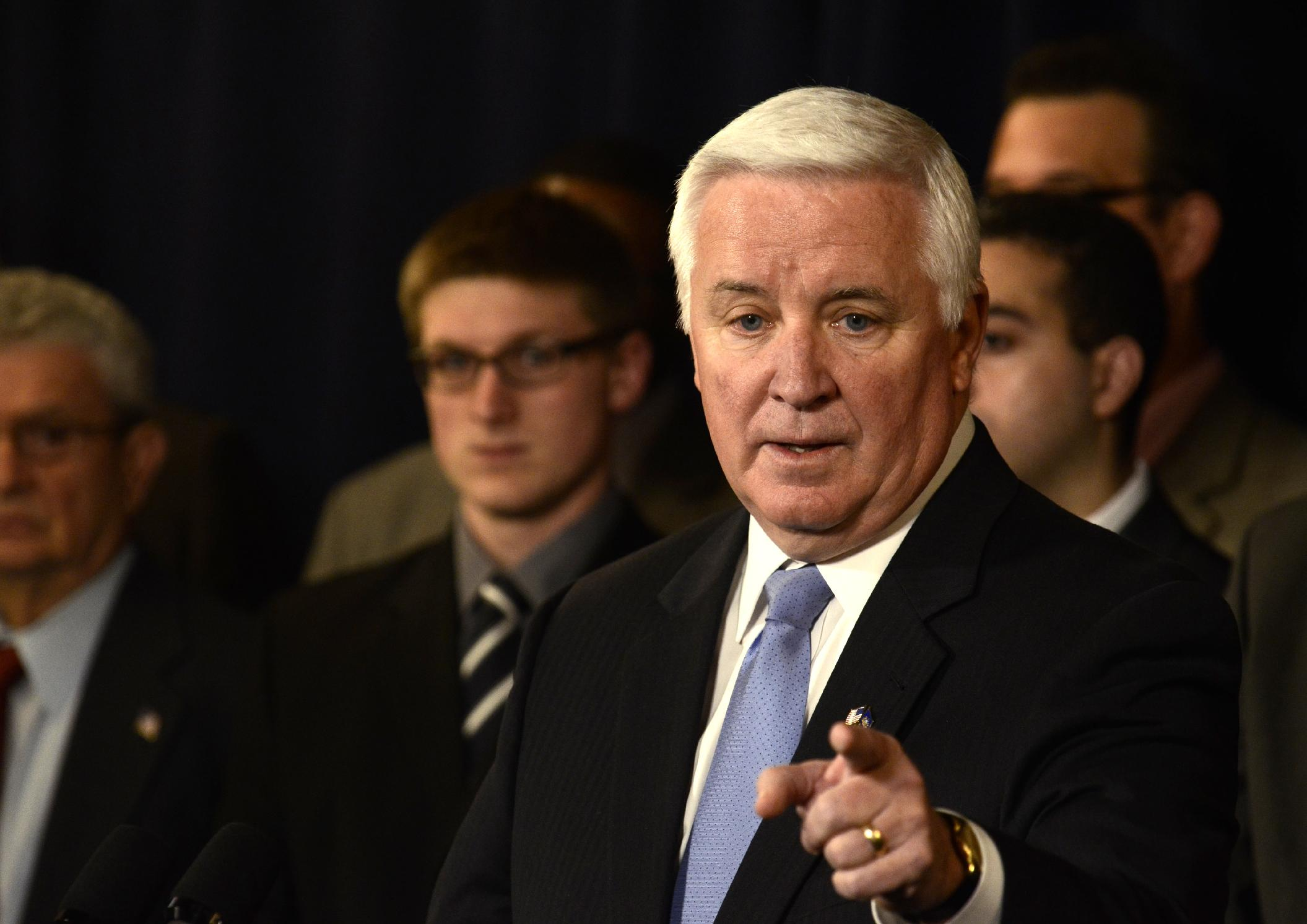 Pennsylvania Gov. Tom Corbett gestures while speaking at a news conference. (AP)