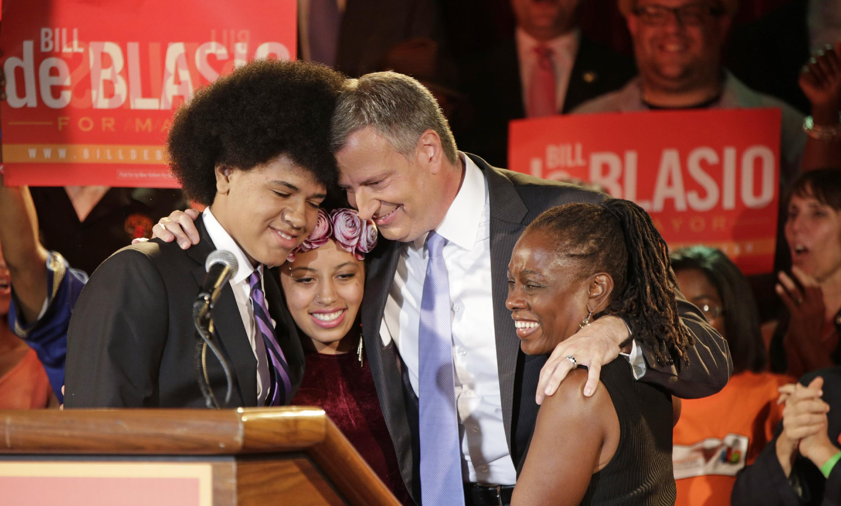 New York City Democratic Mayoral hopeful Bill De Blasio embraces his son Dante, left, daughter Chiara, second from left, and wife Chirlane, right, after addressing supporters at his election headquarters after polls closed in the city's primary election Wednesday, Sept. 11, 2013, in New York. (AP Photo/Kathy Willens)