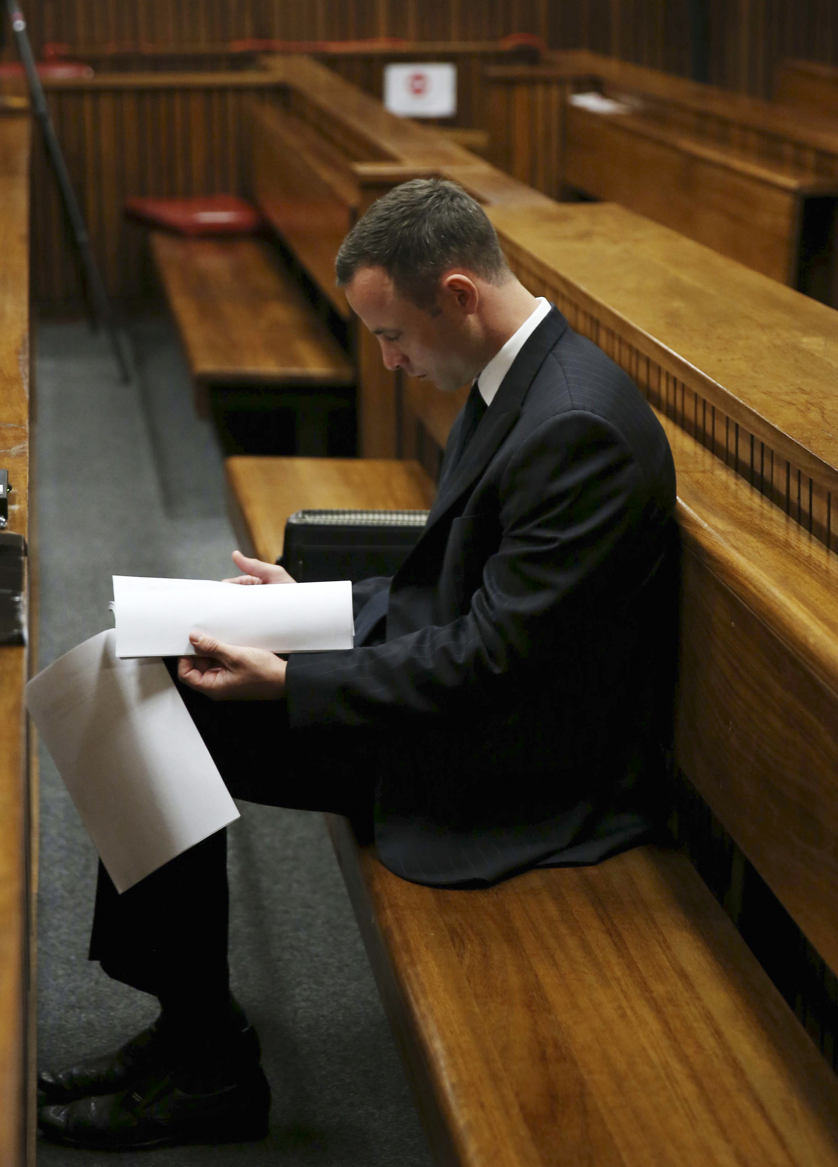 Oscar Pistorius sits in the dock at a court in Pretoria, South Africa, Tuesday, March 25, 2014. Pistorius is charged with the Valentines Day 2013 shooting death of his girlfriend Reeva Steenkamp. (AP Photo/Esa Alexander, Pool)