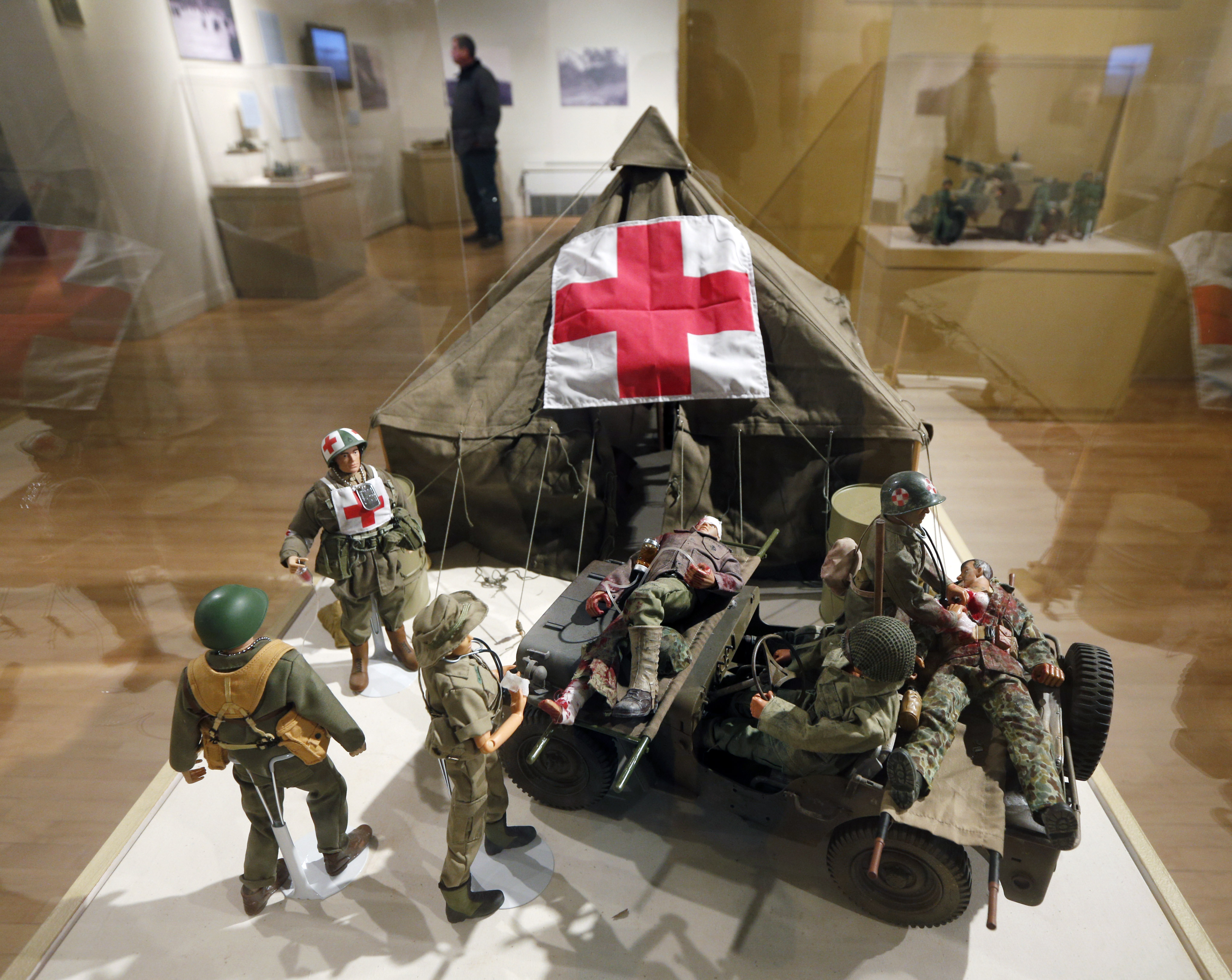 In this Jan. 31, 2014 photo shows G.I. Joe action figures are arranged in a mobile army surgical hospital in a display at the New York State Military Museum in Saratoga Springs, N.Y. A half-century after the 12-inch doll was introduced at a New York City toy fair, the iconic action figure is being celebrated by collectors with a display at the military museum, while the toy's maker plans other anniversary events to be announced later this month. (AP Photo/Mike Groll)