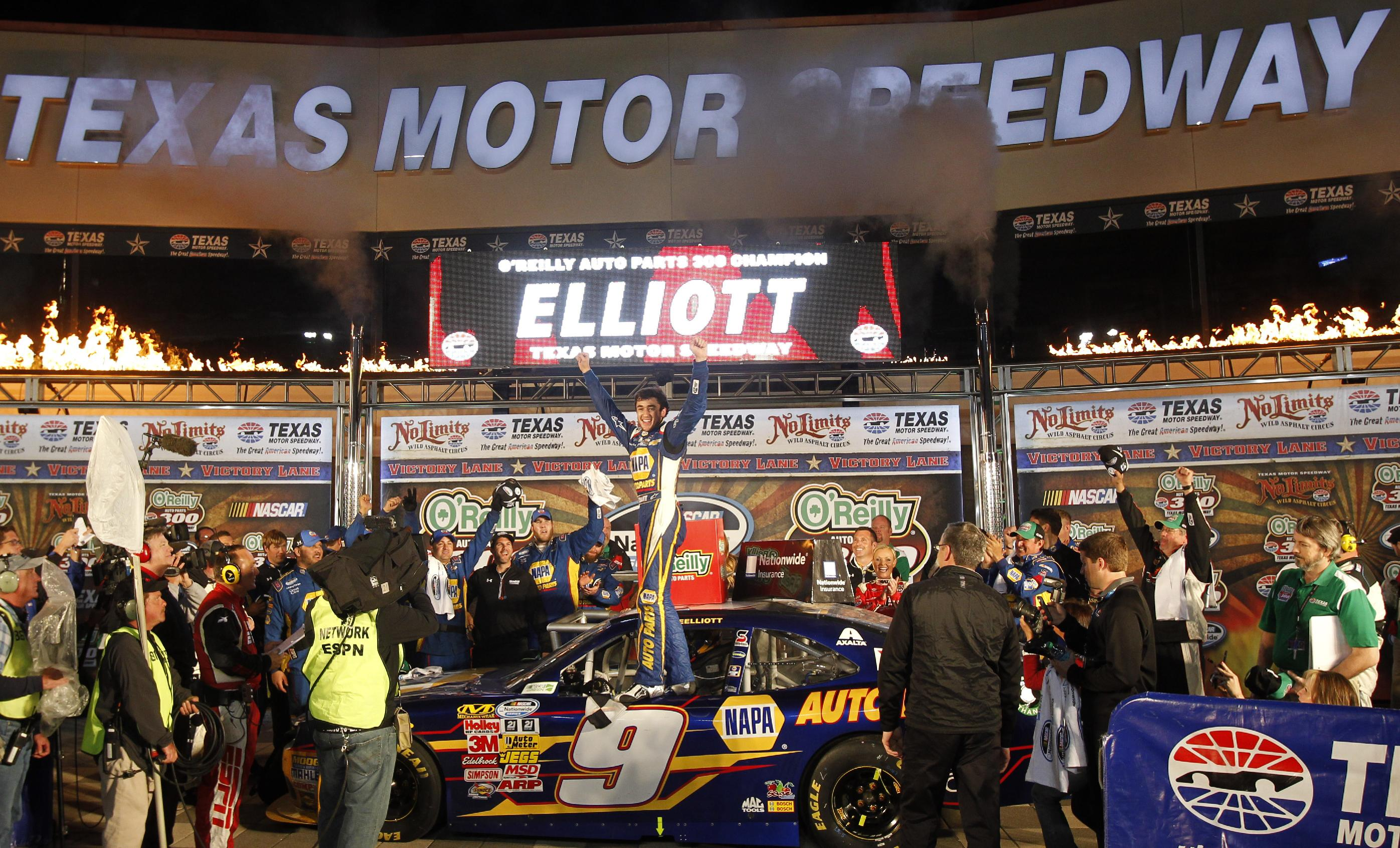 Chase Elliott celebrates his win in the NASCAR Nationwide Series auto race at Texas Motor Speedway in Fort Worth, Texas, Friday, April 4, 2014. (AP Photo/Larry Papke) AP Photo/Mike Stone)