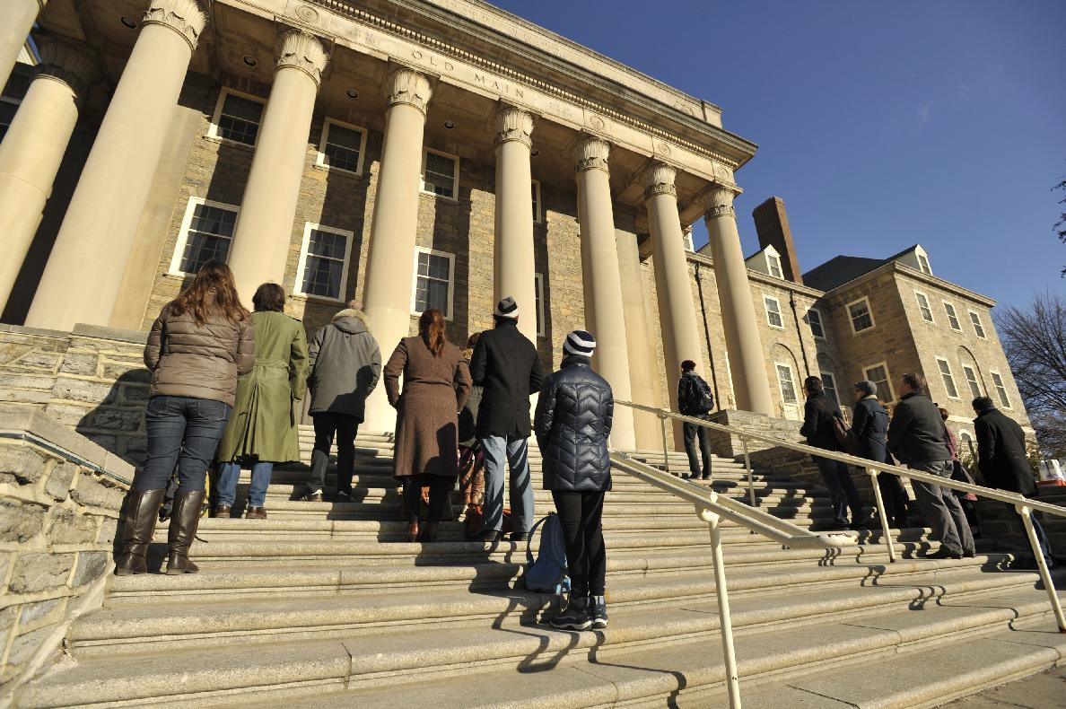 Women pictured on Penn St. frat's Facebook page talk to cops