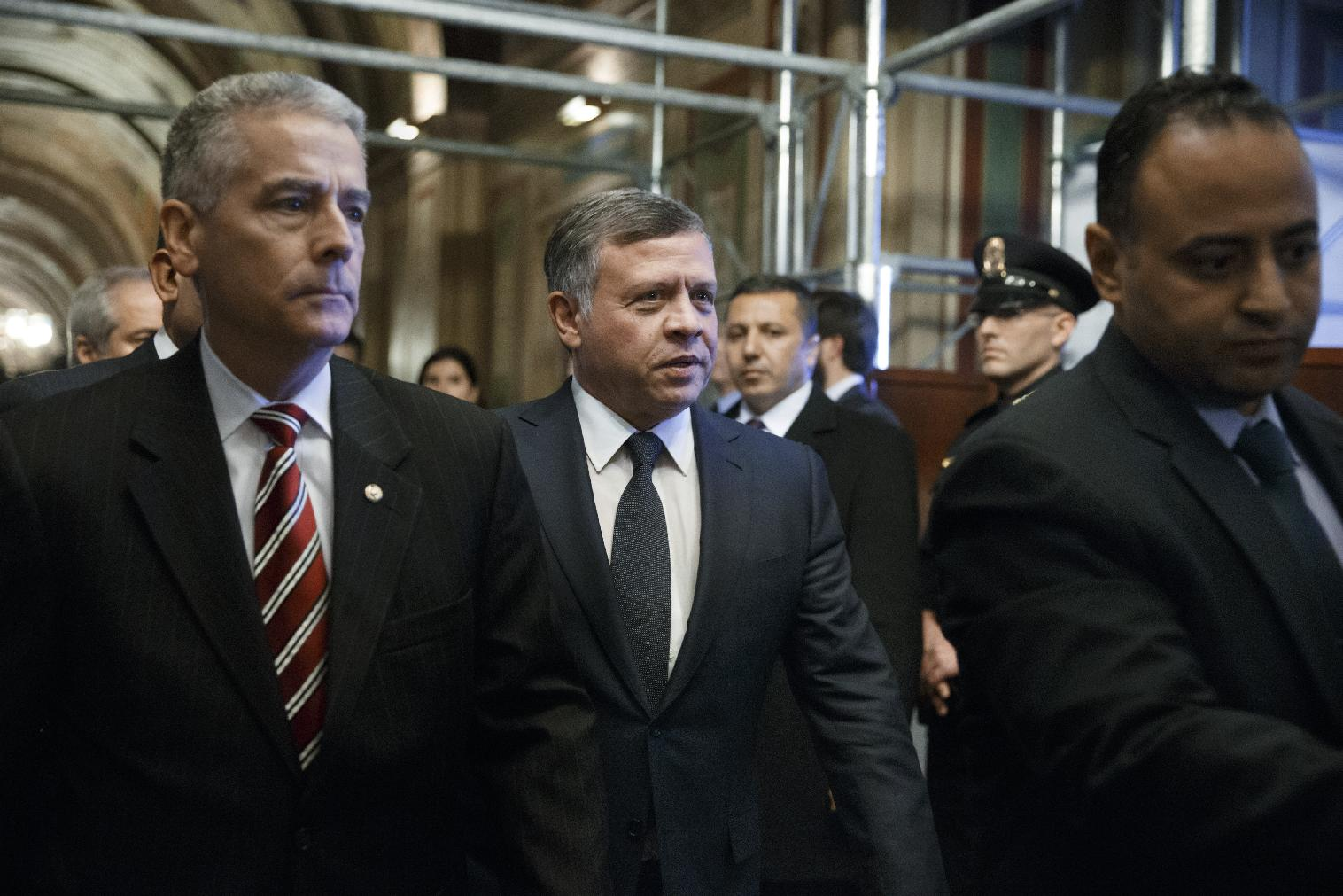 King Abdullah of Jordan , center, is hurried into a meeting with leaders of the Senate Foreign Relations Committee at the Capitol in Washington, Tuesday, Feb. 3, 2015. It was announced today that a Jordanian pilot captured by the Islamic State has been killed. A video released online Tuesday purportedly showed a Jordanian pilot captured by the Islamic State extremist group in Syria being burned to death by his captors following a weeklong drama over a possible prisoner exchange. Jordan threatened a harsh response to the killing of Lt. Muath Al-Kaseasbeh, 26, who fell into the hands of the militants in December when his F-16 crashed in Syria. (AP Photo/J. Scott Applewhite)