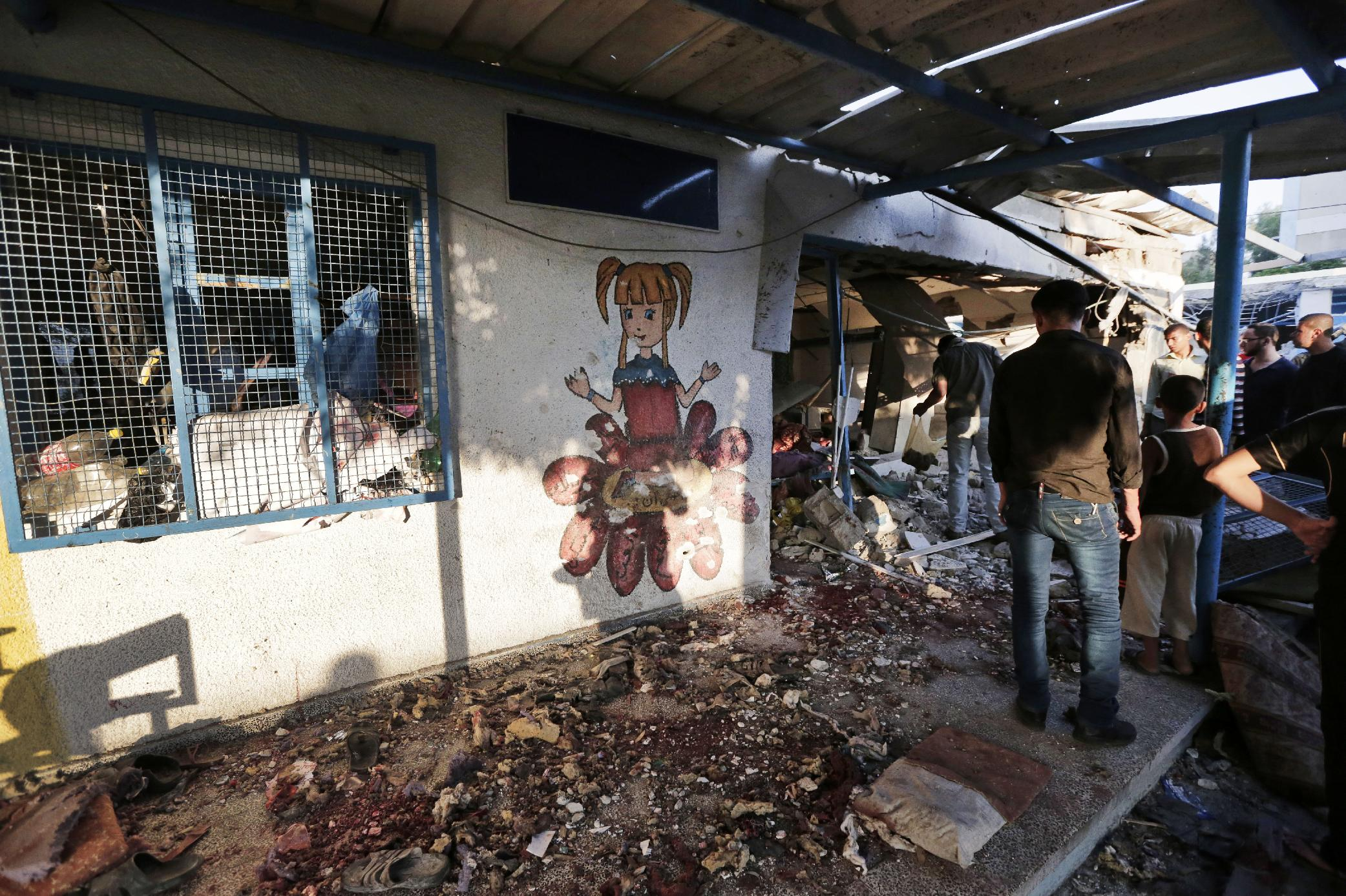 Shells hit UN school in Gaza, kill 15