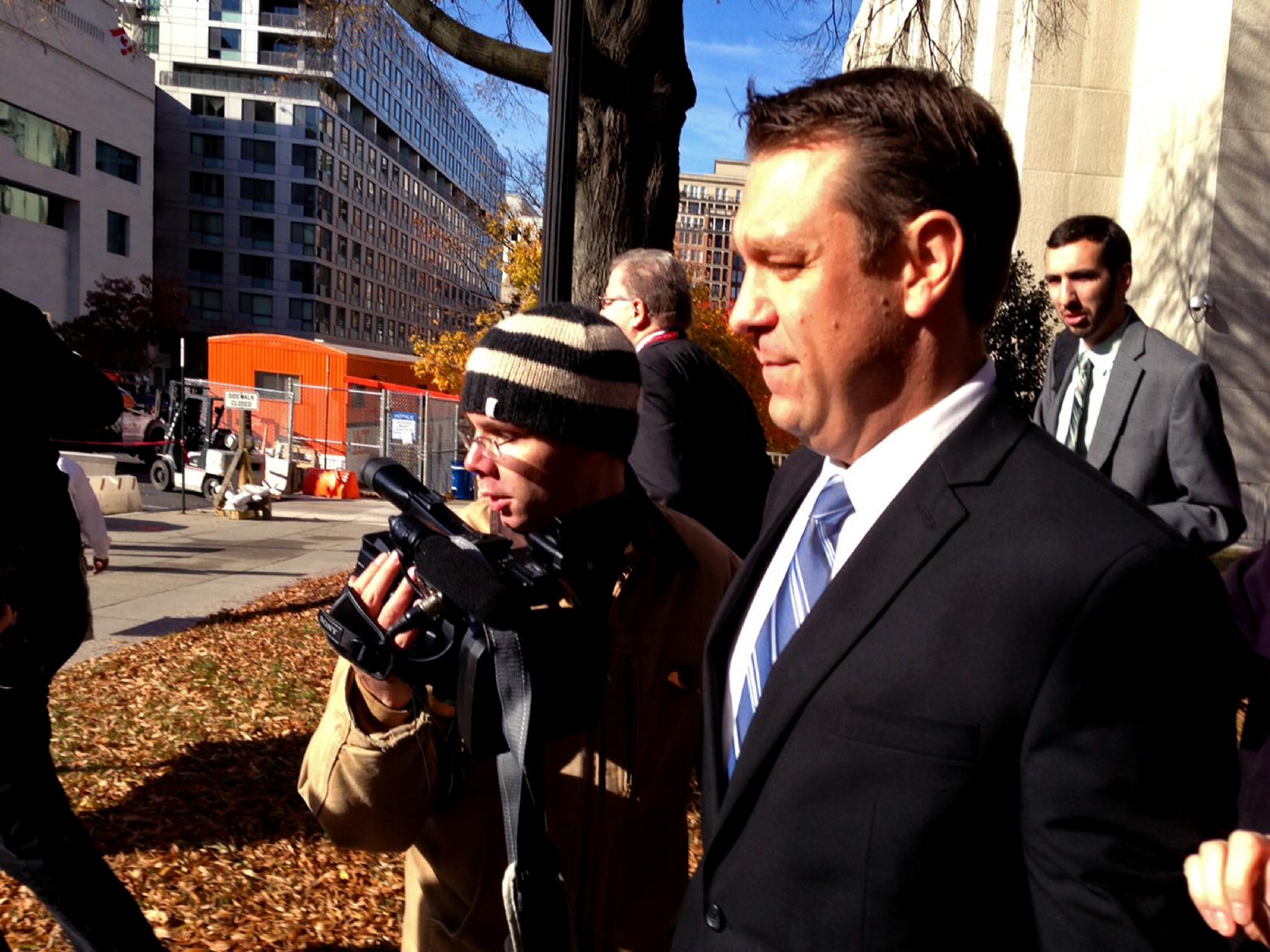 """This photo taken with a cellphone shows Rep. Henry """"Trey"""" Radel, R-Fla. leaving court in Washington, Wednesday, Nov. 20, 2013, leaving court after pleading guilty to a misdemeanor charge of cocaine possession and was sentenced to a year's probation. (AP Photo/Jessica Gresko)"""
