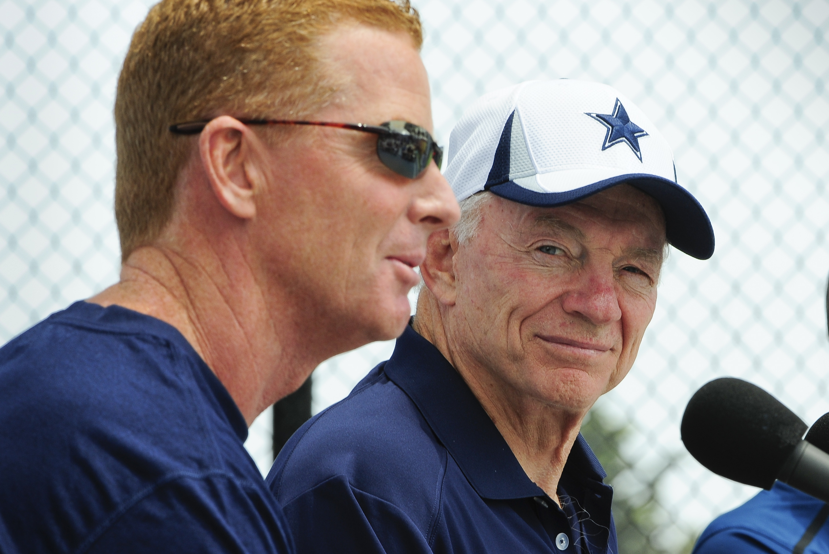 Dallas Cowboys owner Jerry Jones watches as coach Jason Garrett answers the media. (AP)