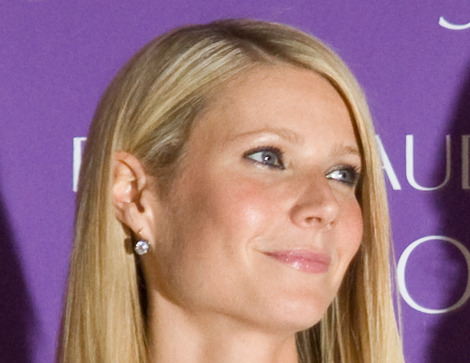 Gwyneth Paltrow wears sheer blouses and sheer dressed.