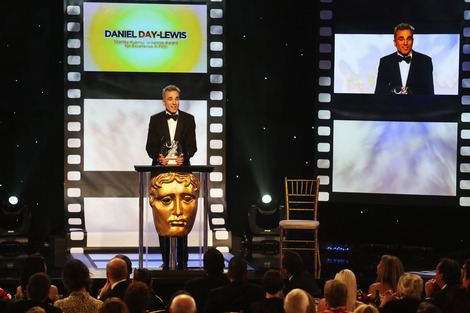 Daniel Day-Lewis talks to an empty chair at the 2012 Britannia Awards on November 7, 2012.