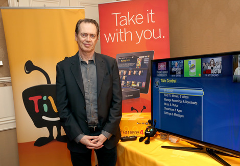 Steve Buscemi happily contemplates his new TiVo setup at the HBO Luxury Lounge during Golden Globes weekend 2013.