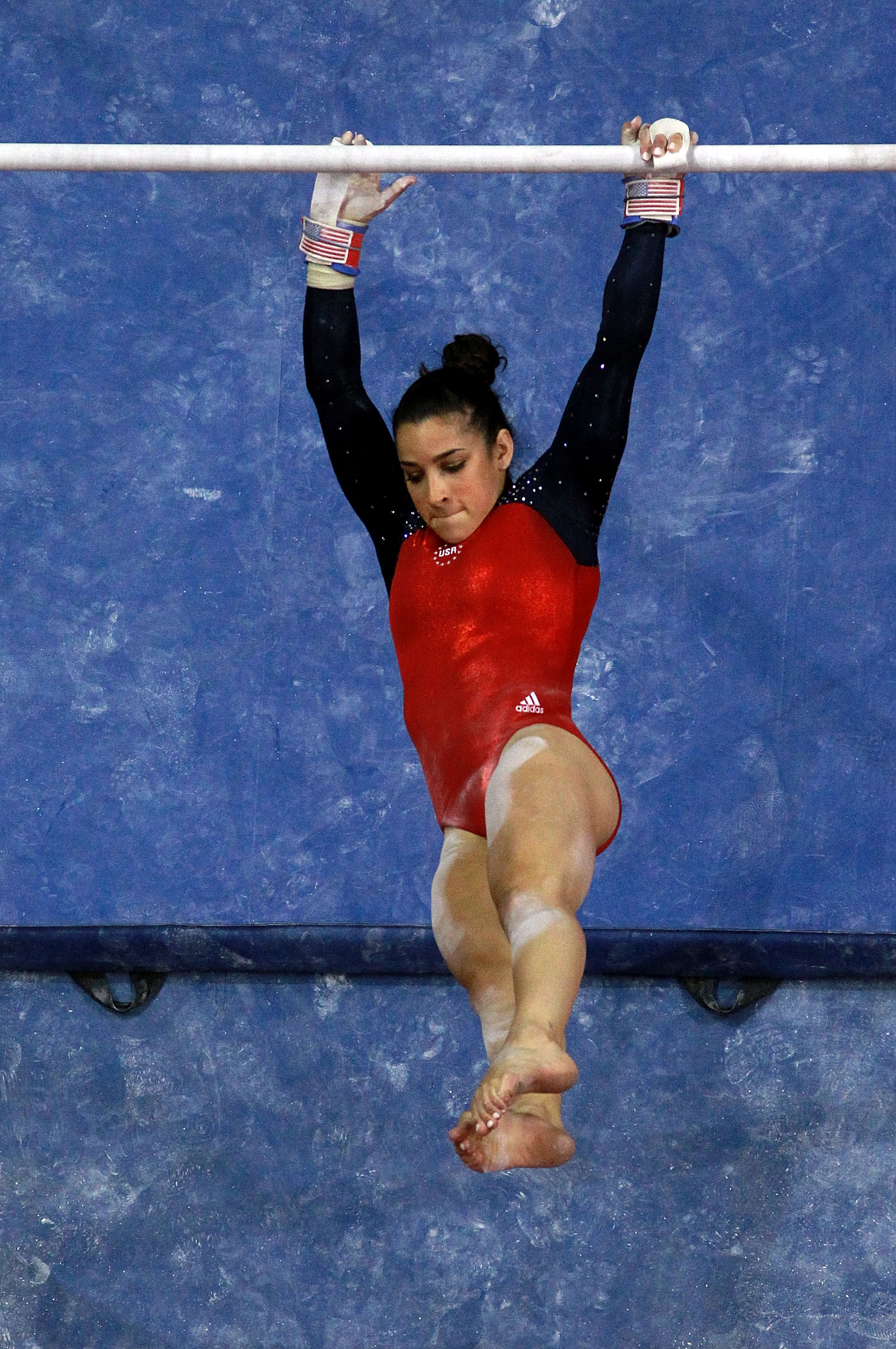 Raisman competes on the uneven bars at the U.S. Olympic Trials. (Getty Images)