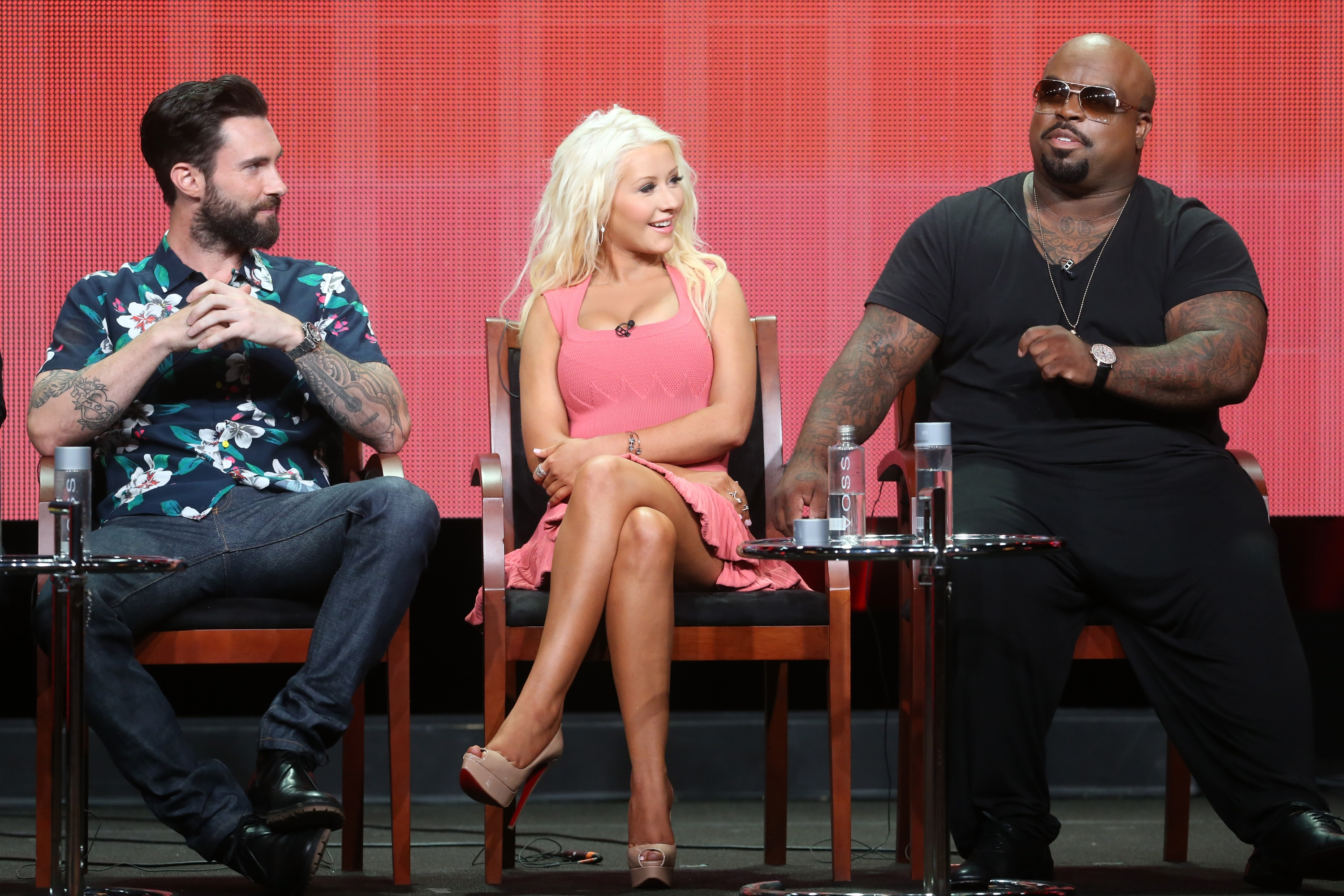 "Coaches Adam Levine, Christina Aguilera, and CeeLo Green at ""The Voice"" panel of the TCAs. (Frederick M. Brown/Getty Images)"