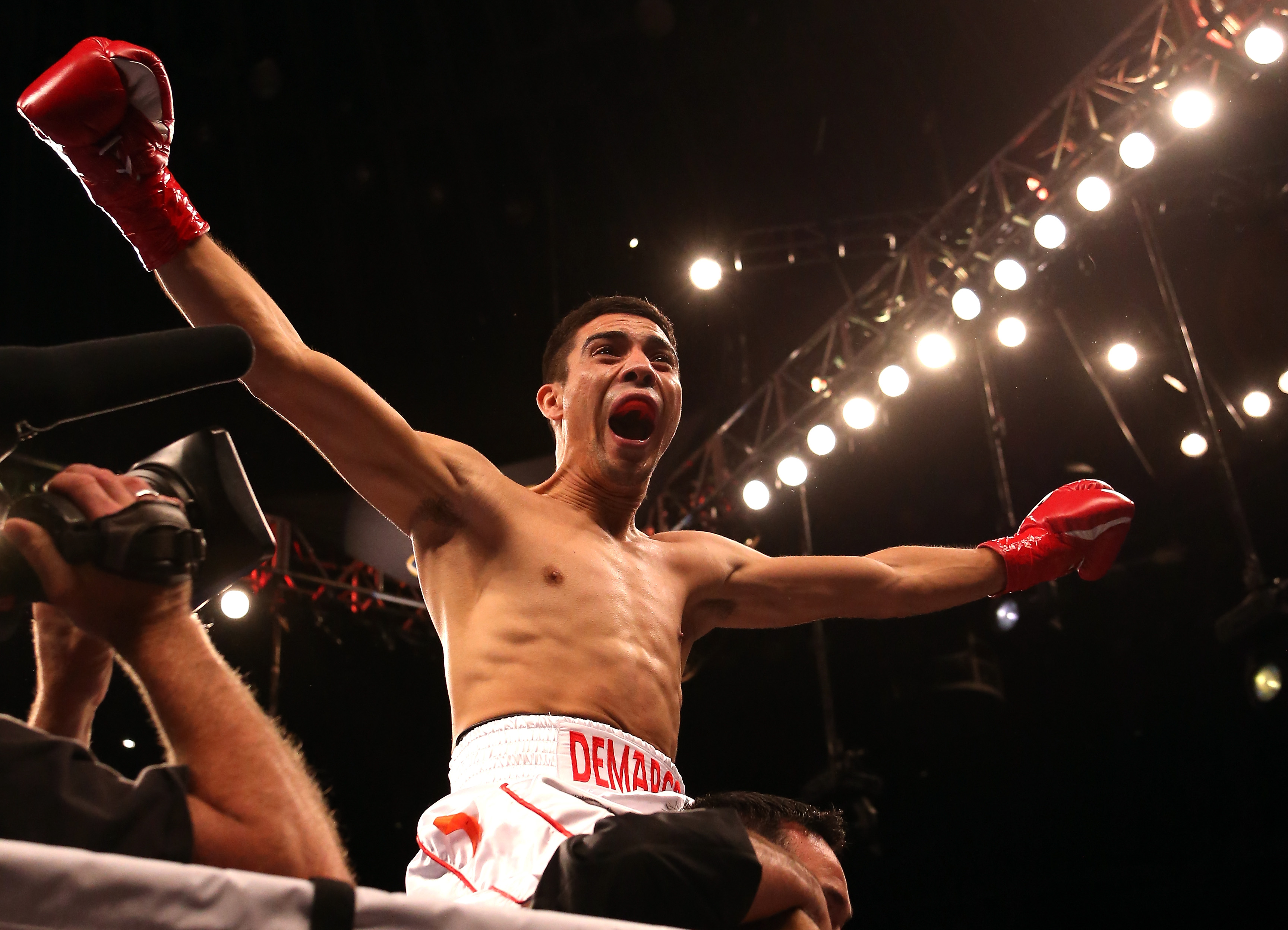 Antonio DeMarco celebrates after beating John Molina Jr. in their Sept. 8 fight. (Getty Images)