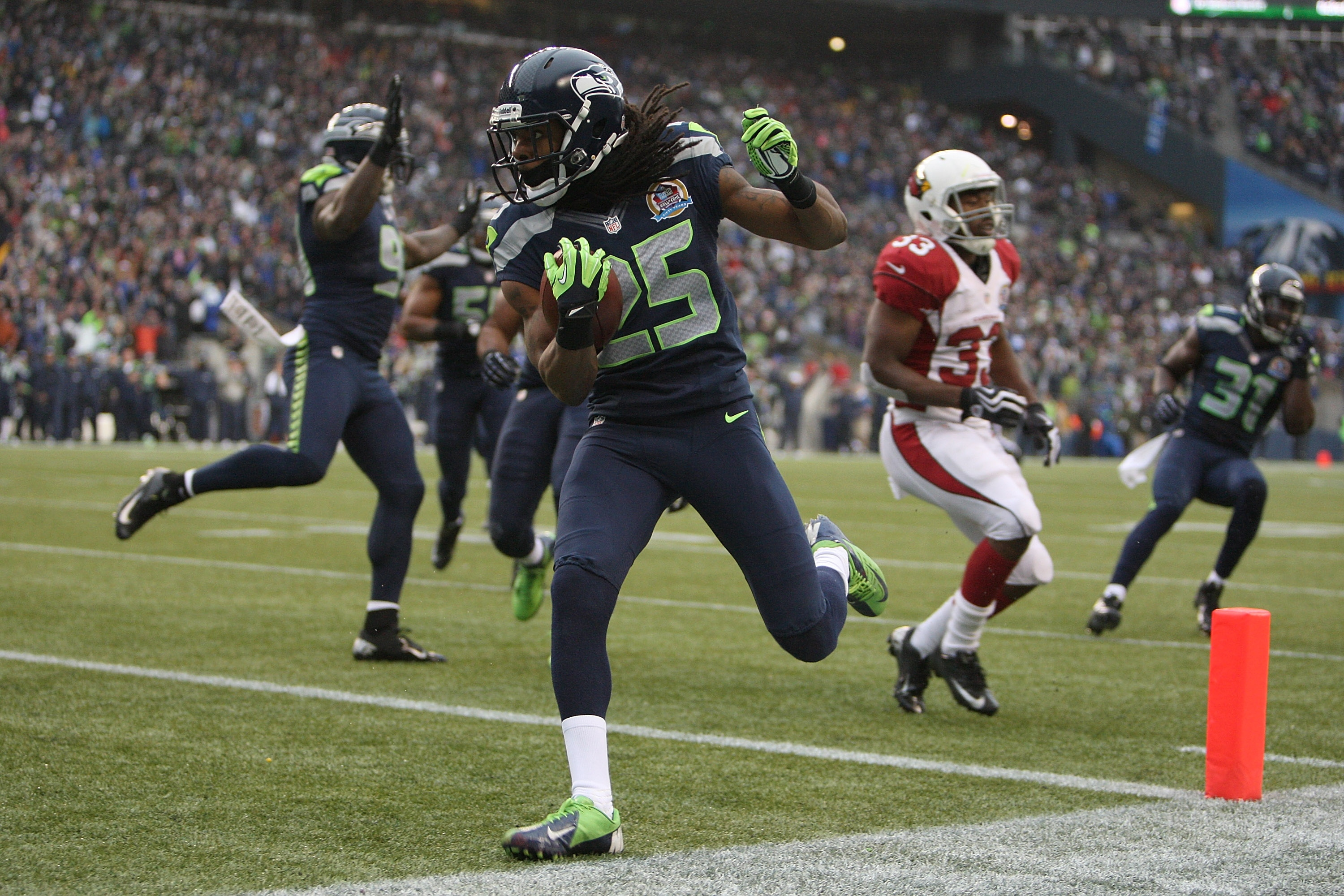 Richard Sherman scores a touchdown on a interception return against the Cardinals. (Getty Images)