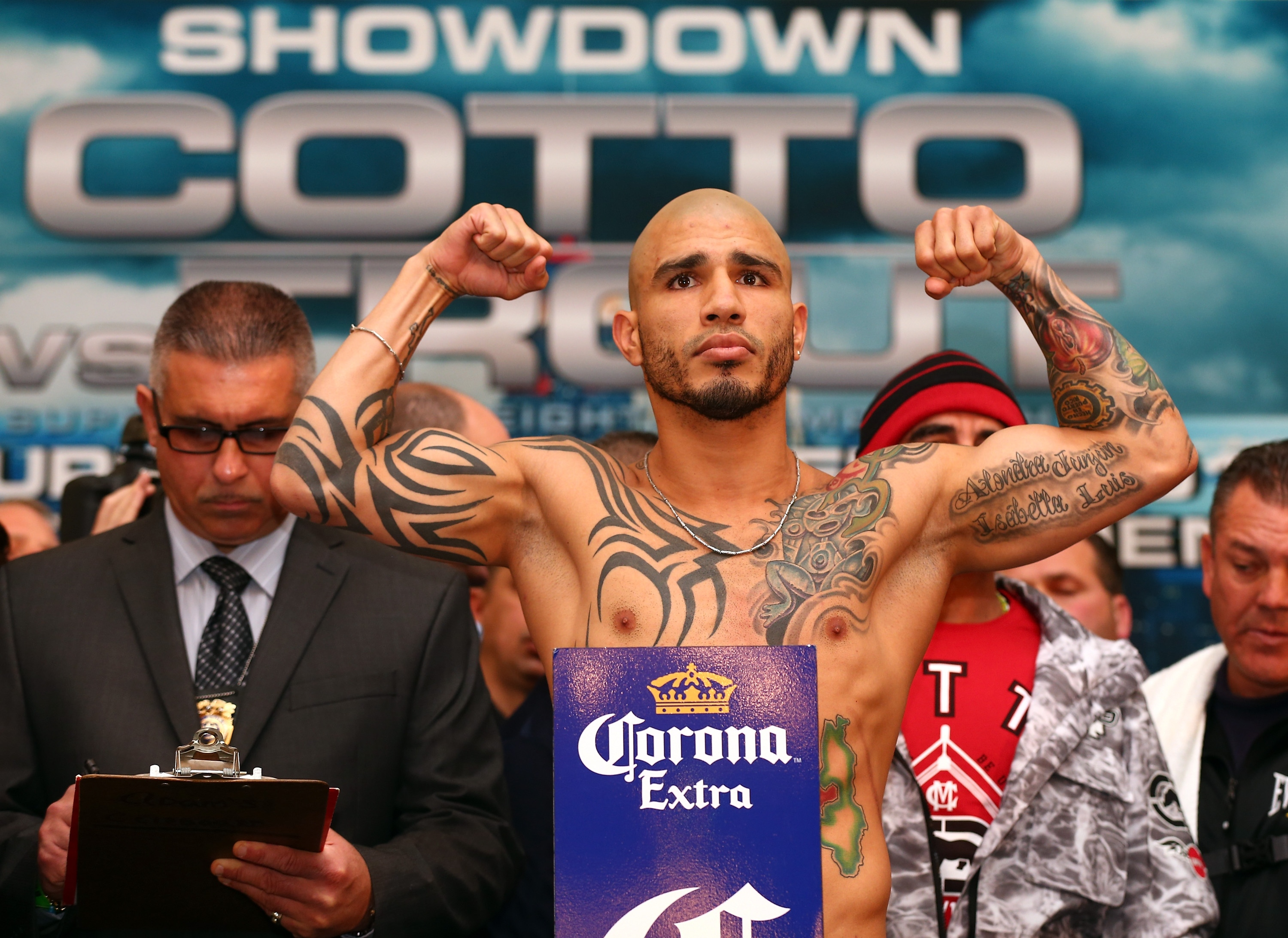 Miguel Cotto poses during the weigh-in for his fight against Austin Trout. (Getty Images)