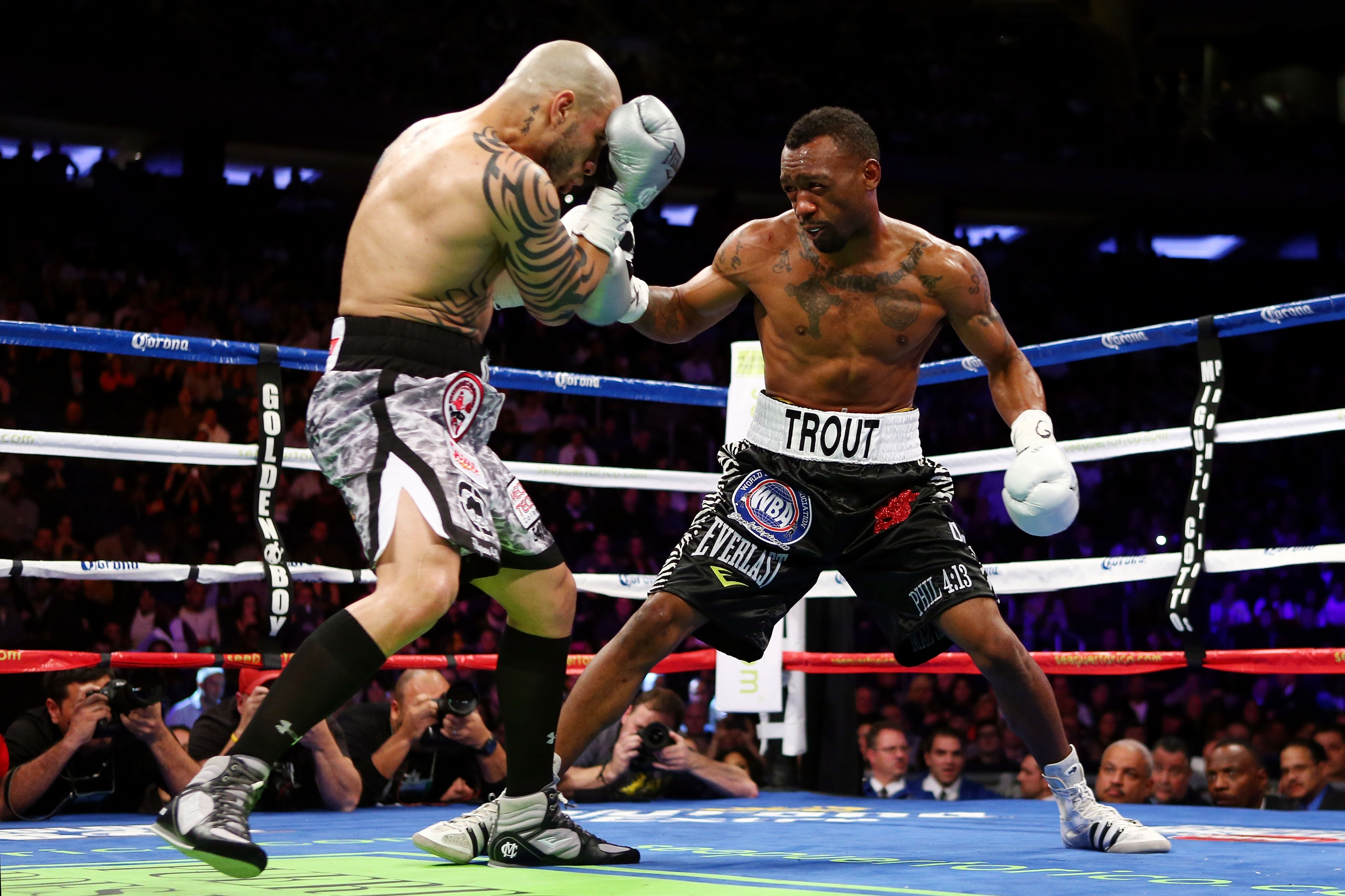 Austin Trout (R) fights against Miguel Cotto in their WBA super welterweight title fight. (Getty)
