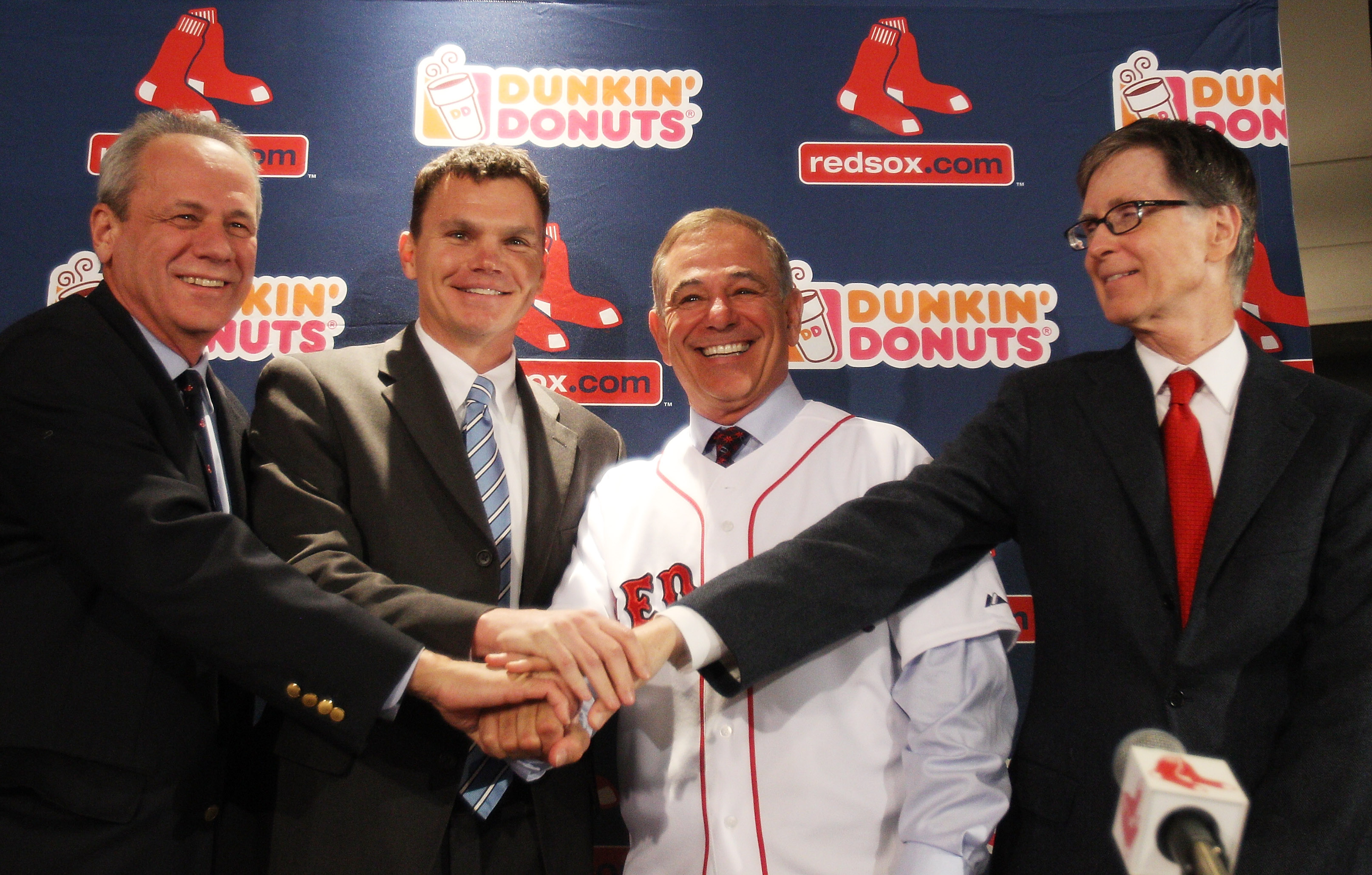 Red Sox president Larry Lucchino, left, has backed his hand-picked manager, Bobby Valentine. (Getty Images)