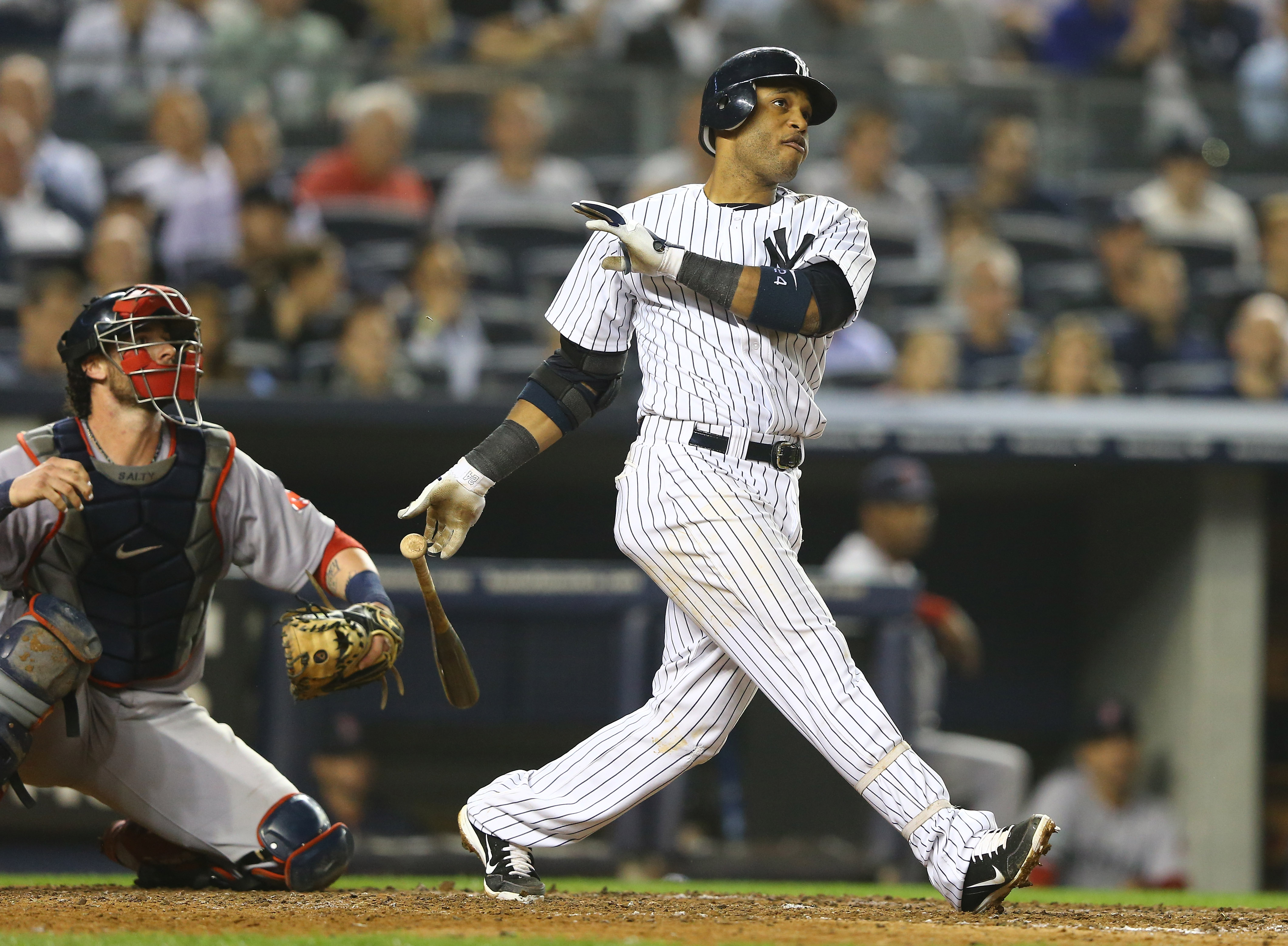 Robinson Cano hit two home runs as the Yankees routed the Red Sox 14-2. (Getty Images)