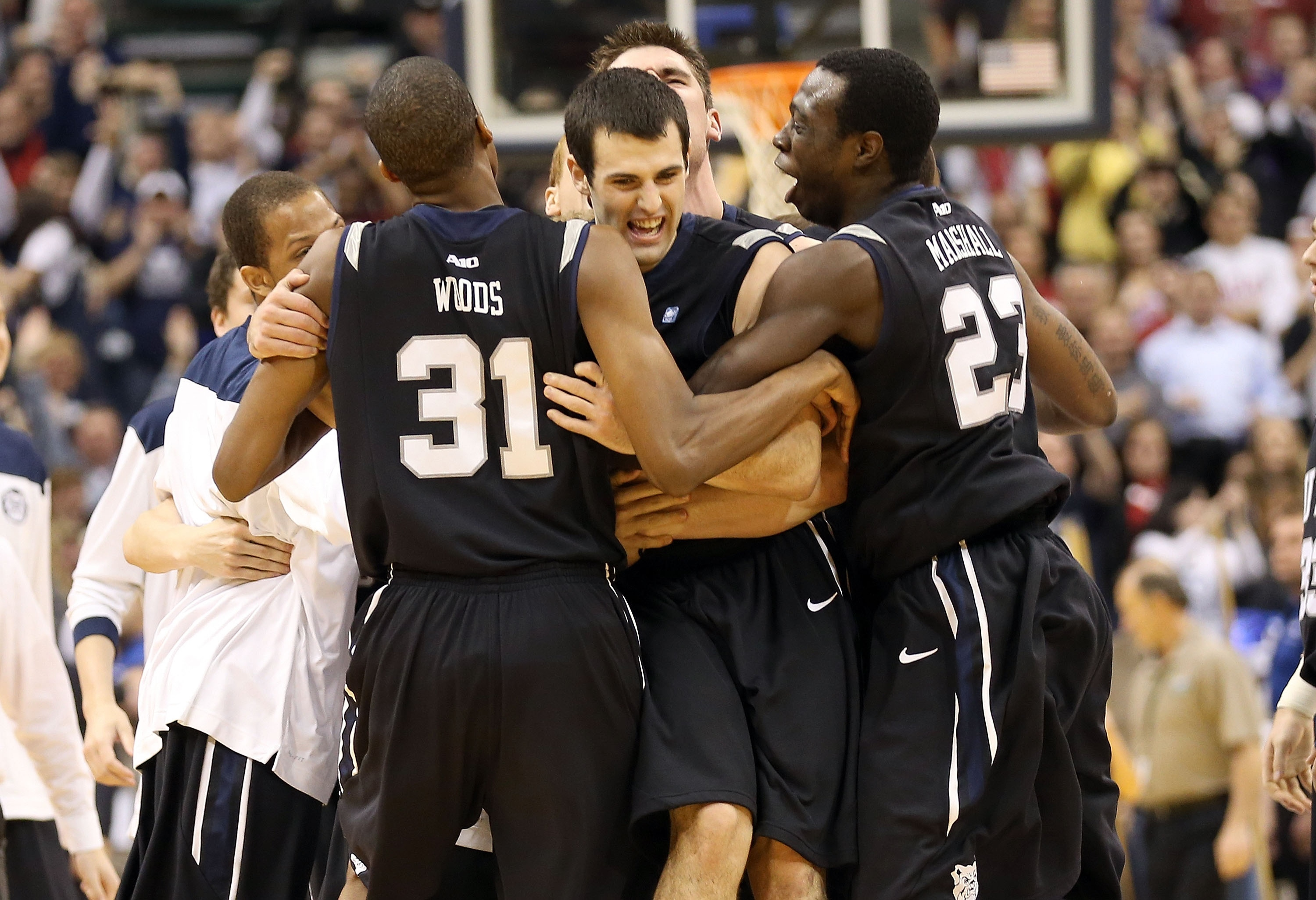 Alex Barlow, center, is mobbed by Butler teammates after beating Indiana. (Getty Images)