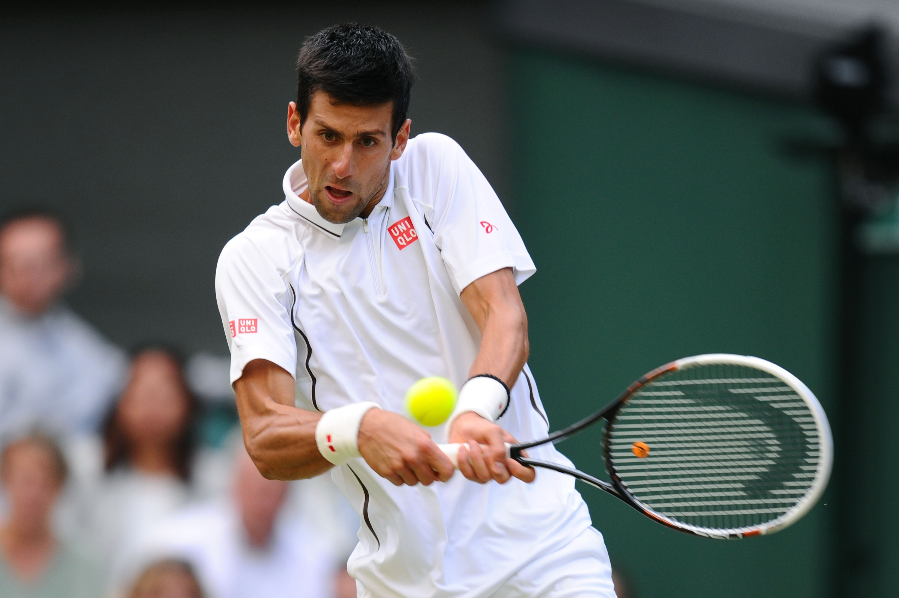 Novak Djokovic plays a backhand during his fourth round match against Tommy Haas. (Getty)
