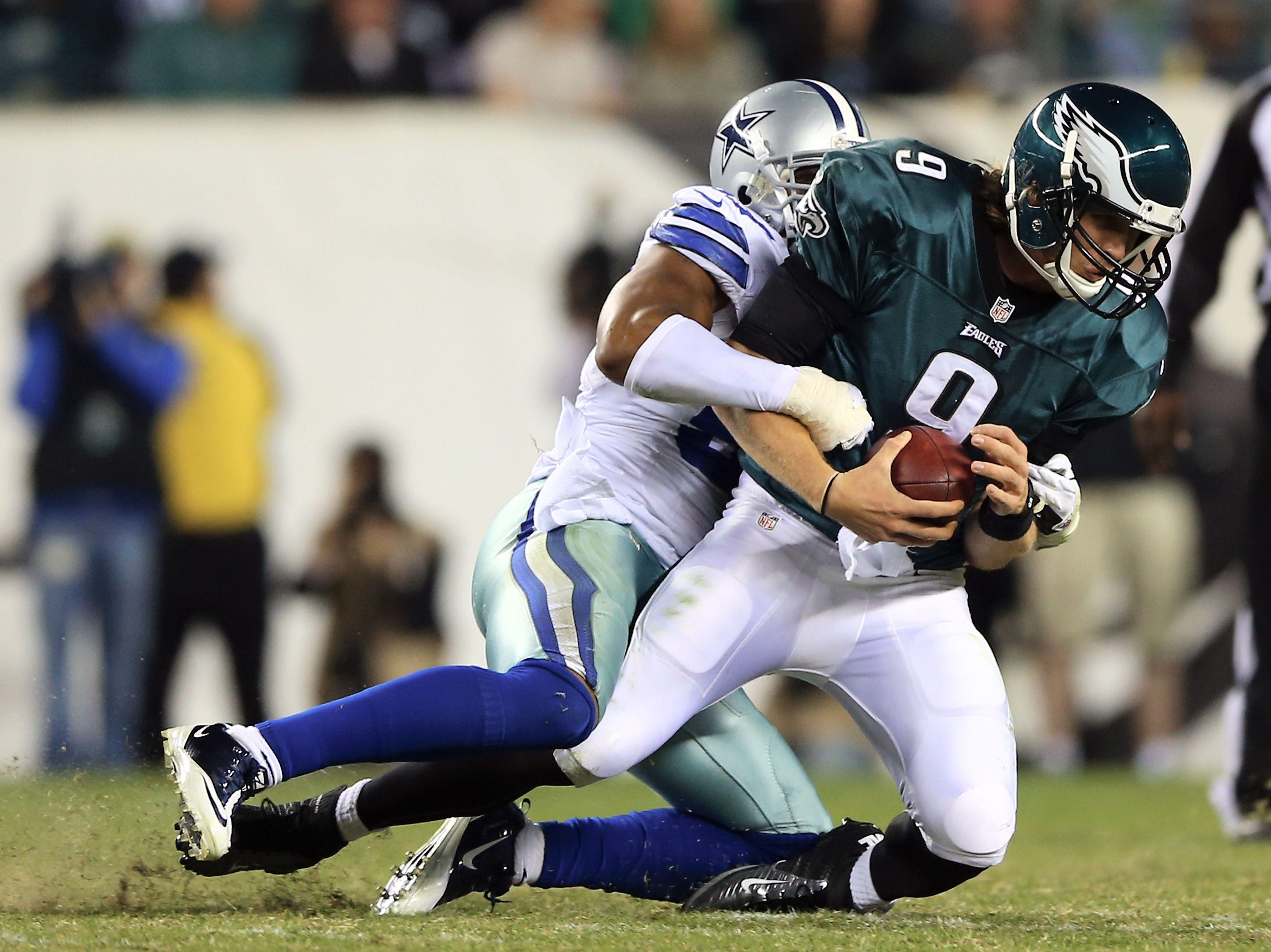 Eagles rookie QB Nick Foles is sacked by Victor Butler in Sunday's loss to the Cowboys. (Getty Images)