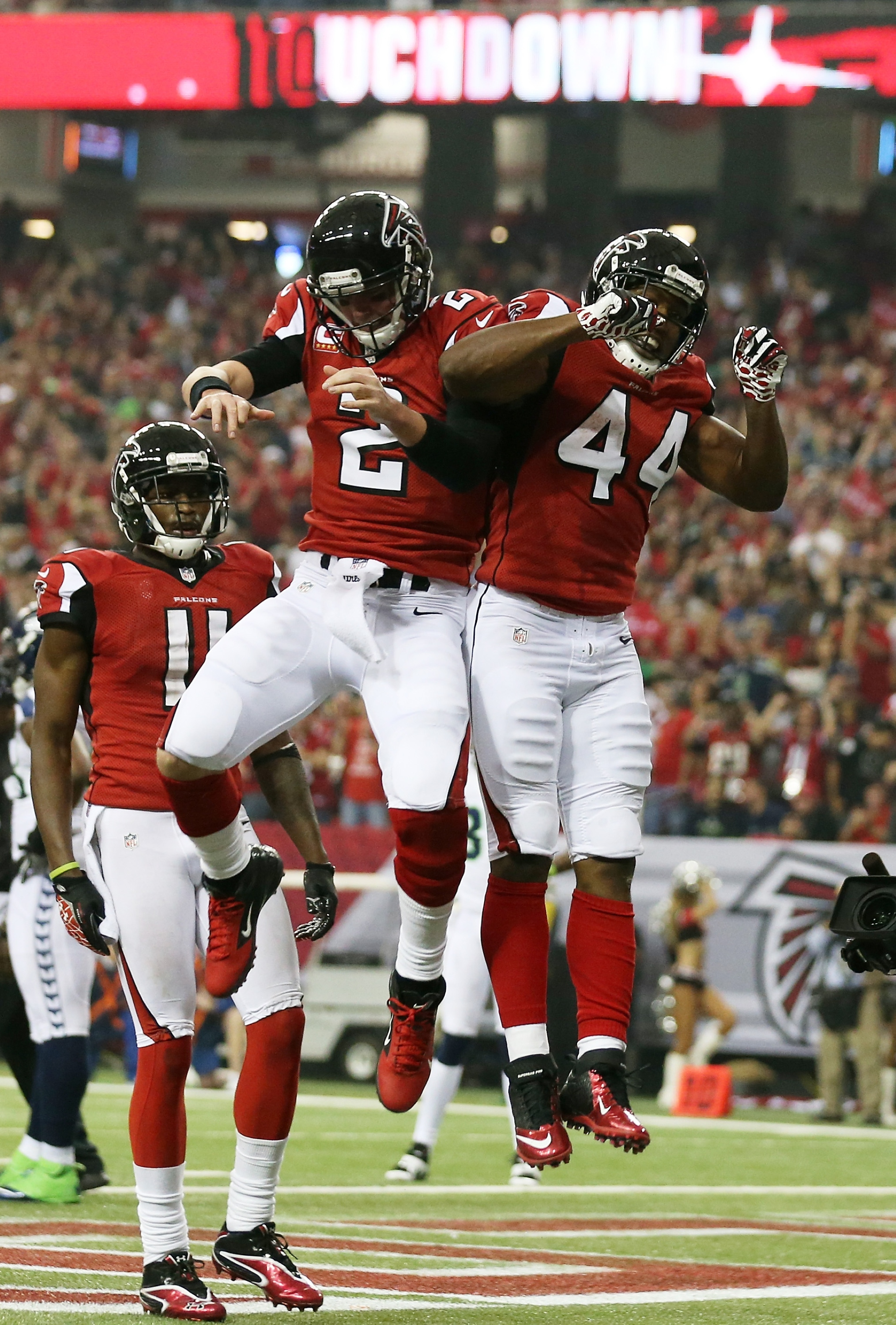 The city of Atlanta is beginning to believe in Matt Ryan, left, Jason Snelling and the Falcons. (Getty Images)