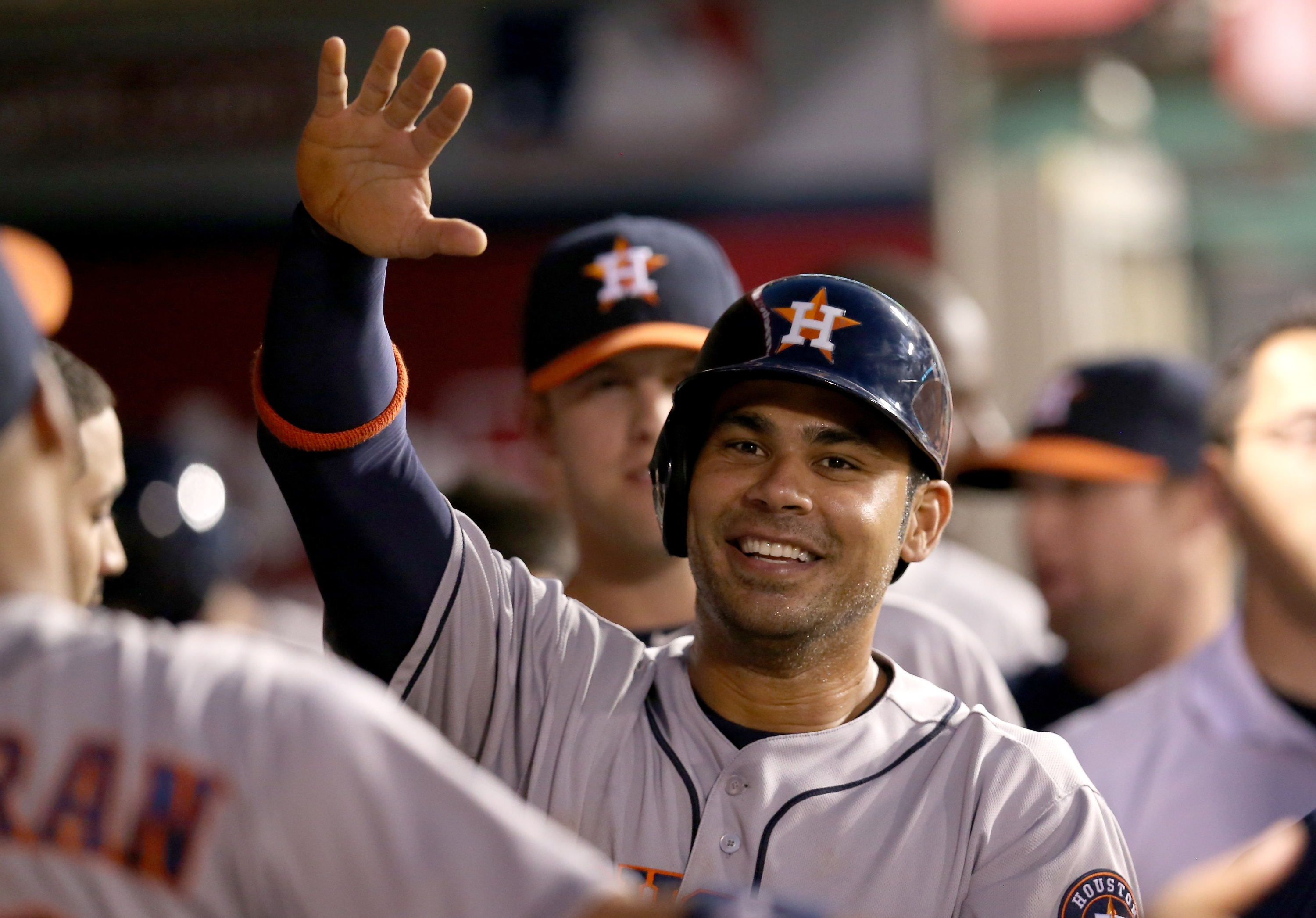 Carlos Pena celebrates in the dugout after scoring a run on a sacrifice fly. (Getty)
