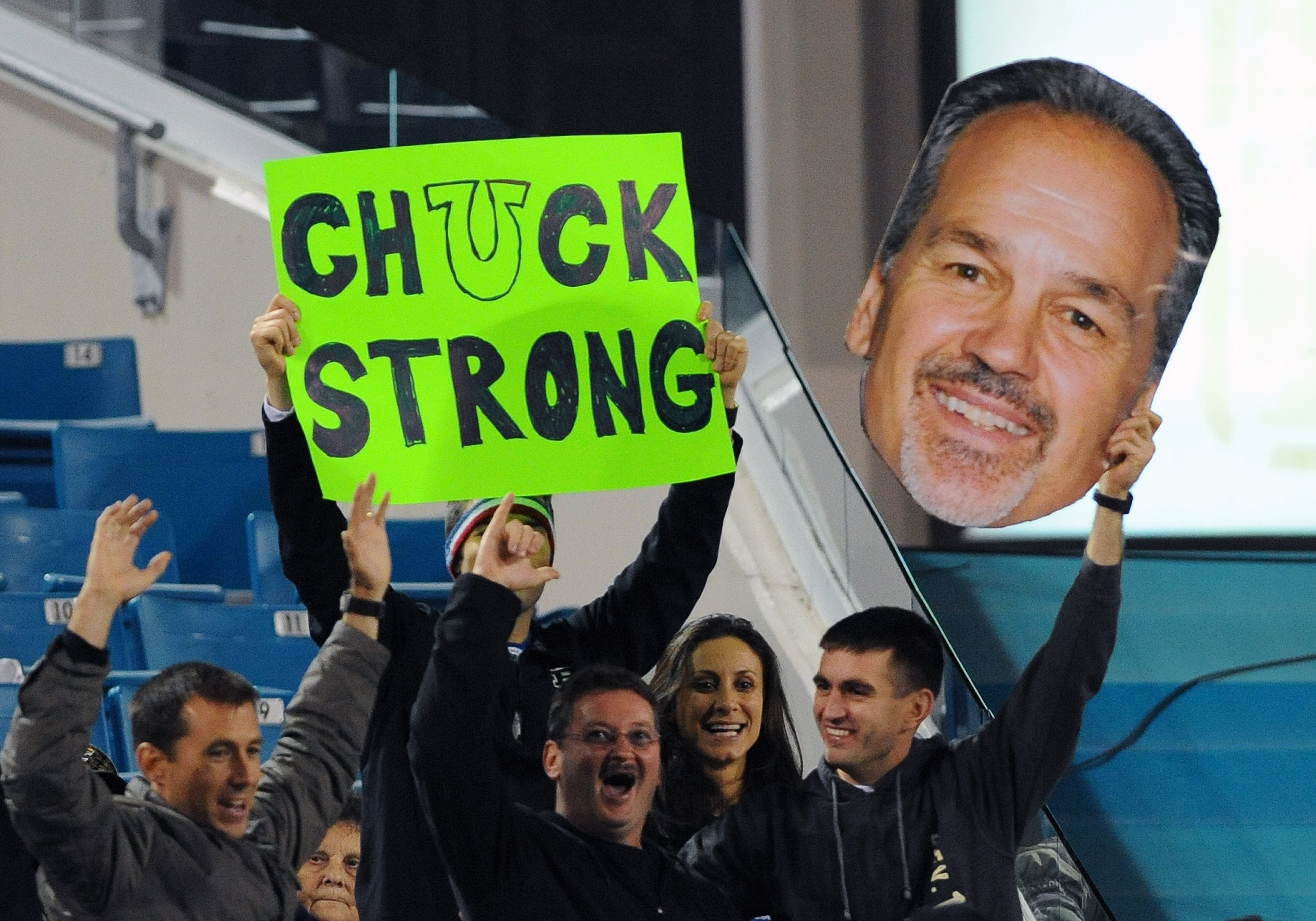 Fans of the Colts show signs supporting coach Chuck Pagano during a game against the Jaguars. (Getty Images)
