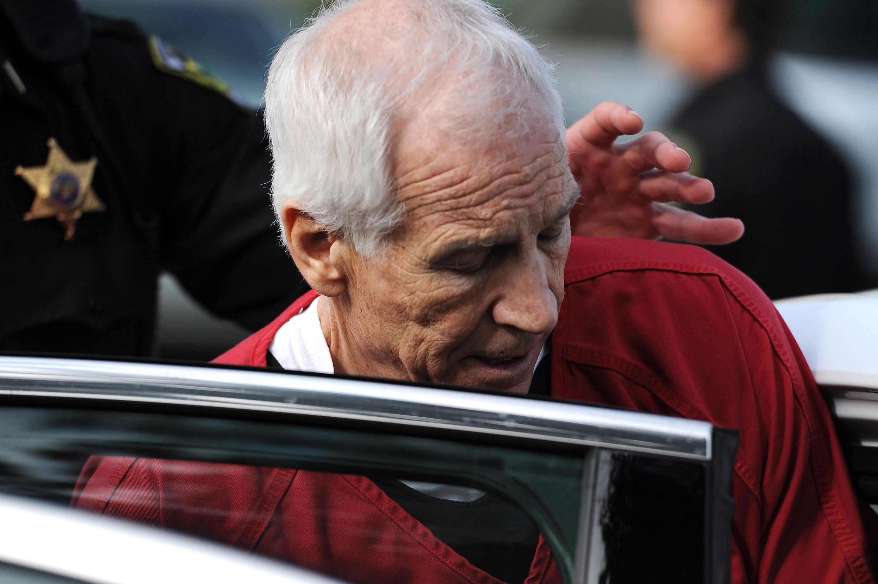 Jerry Sandusky leaves the Centre County Courthouse after his sentencing hearing. (Getty Images)