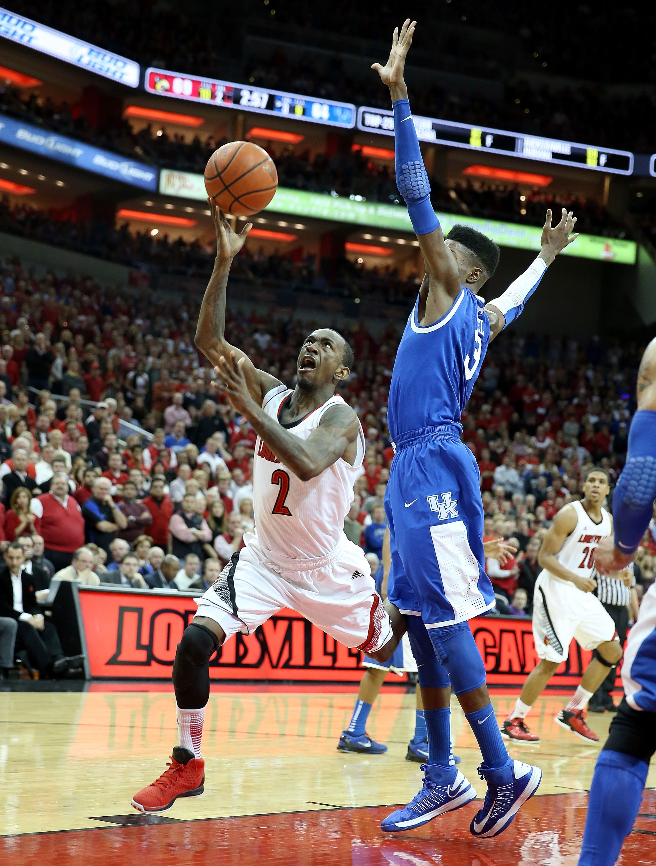 Russ Smith shoots the ball as he goes to the ground. (Getty)