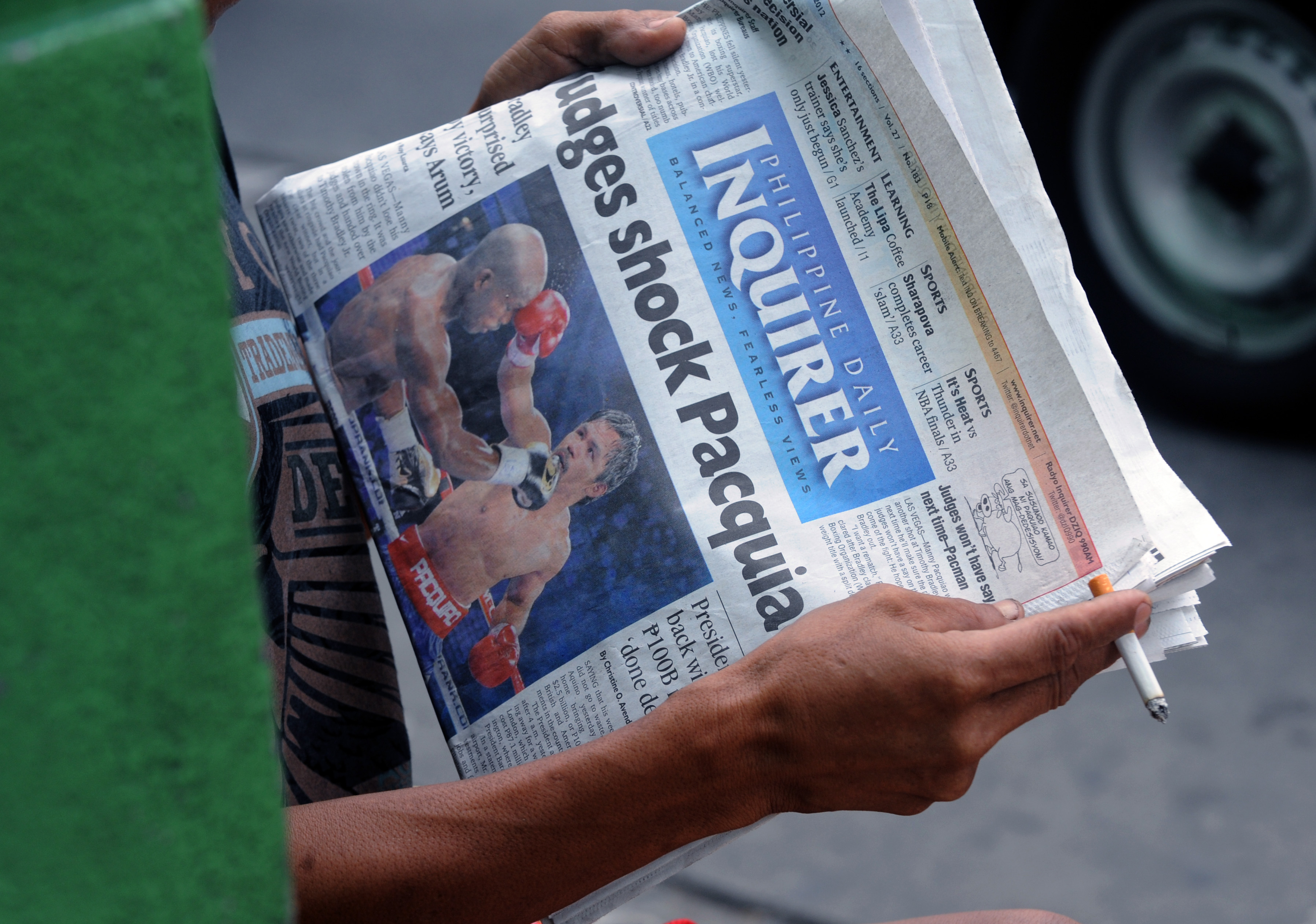 A Philipines newspaper shows Manny Pacquiao's controversial defeat to Timothy Bradley. (Getty Images)