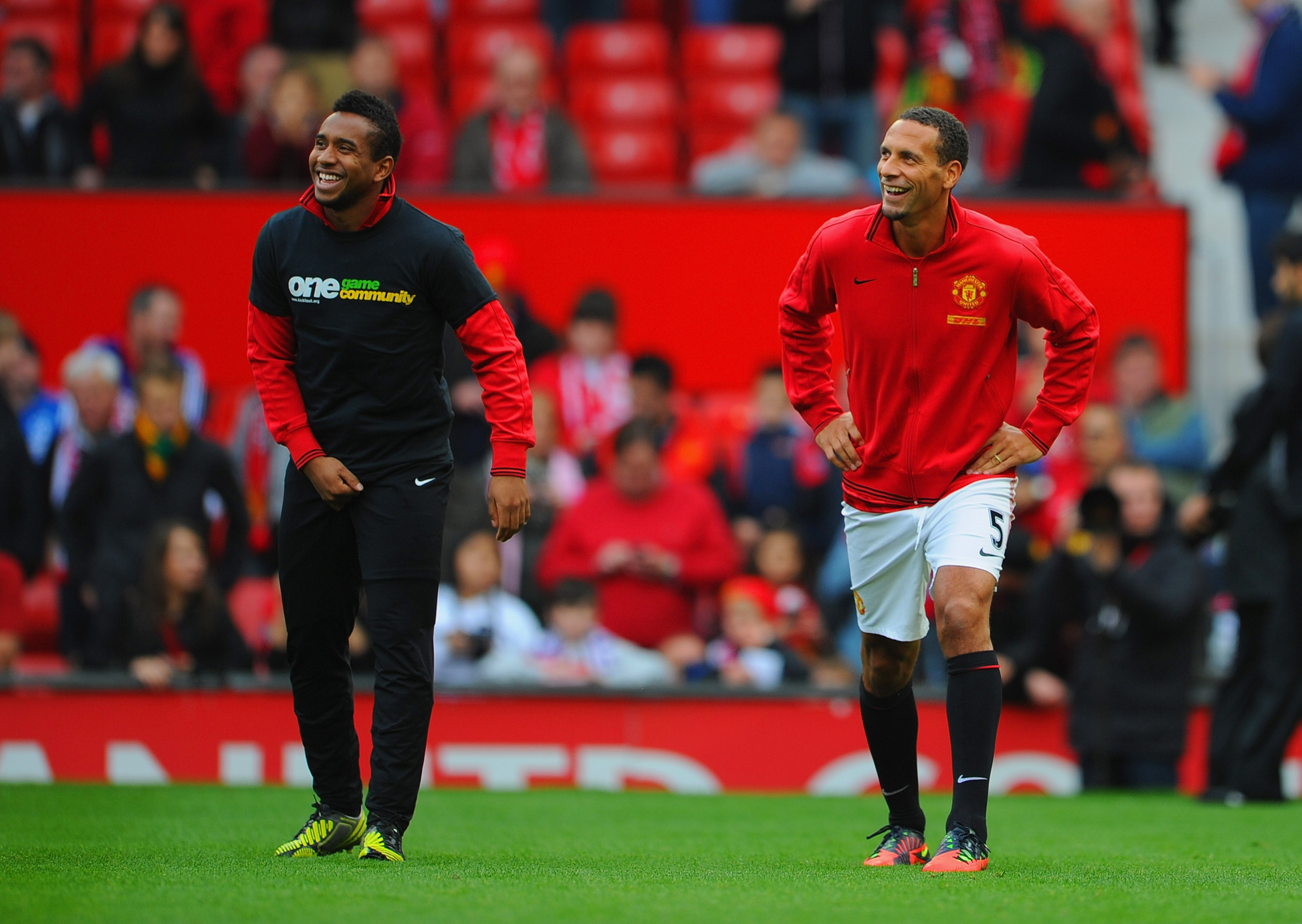 Anderson wears a T-shirt for the Kick It Out campaign. Rio Ferdinand, right, did now wear the shirt. (Getty Images)