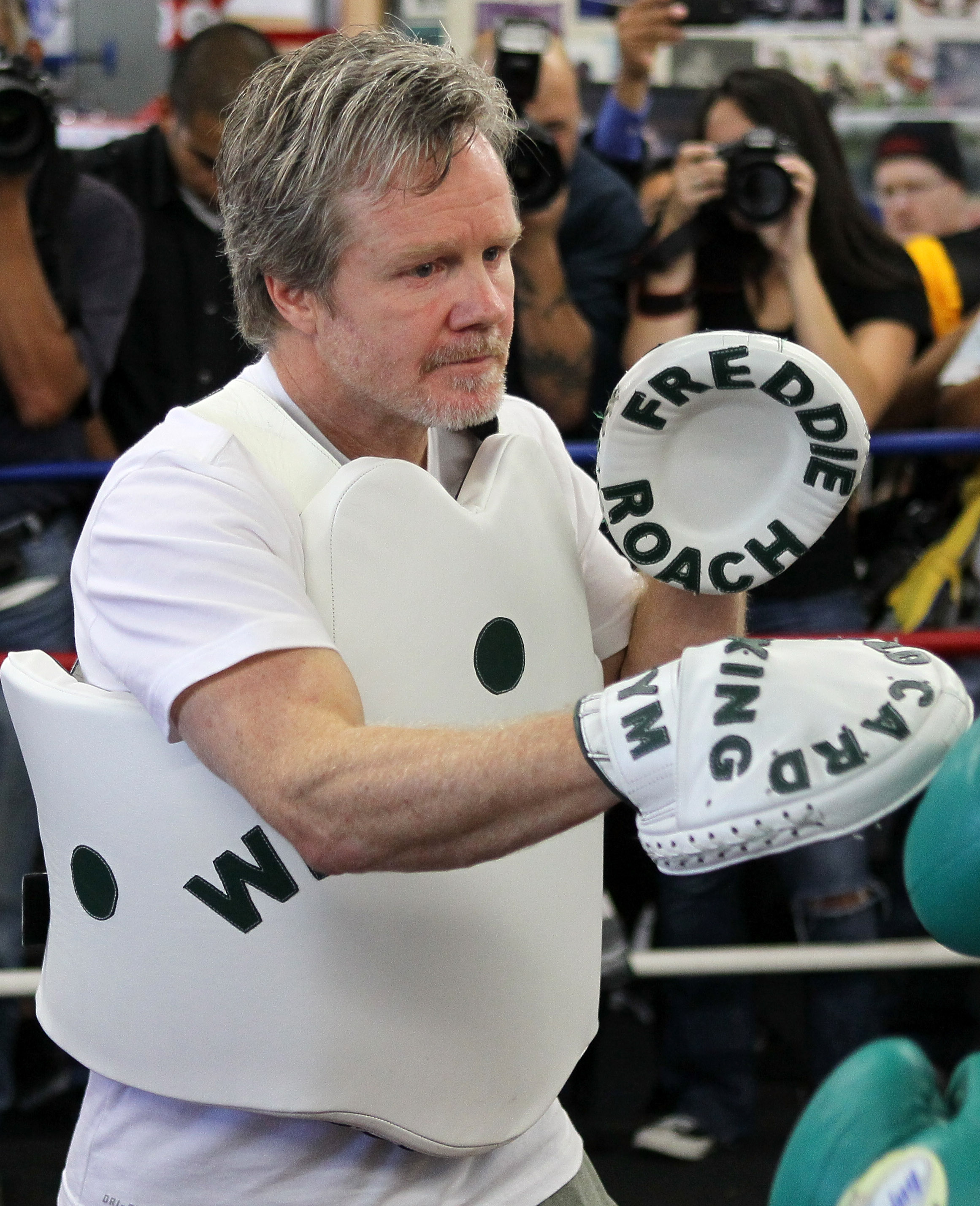 Freddie Roach thinks he is still part of the Olympic team's training program. (Getty Images)