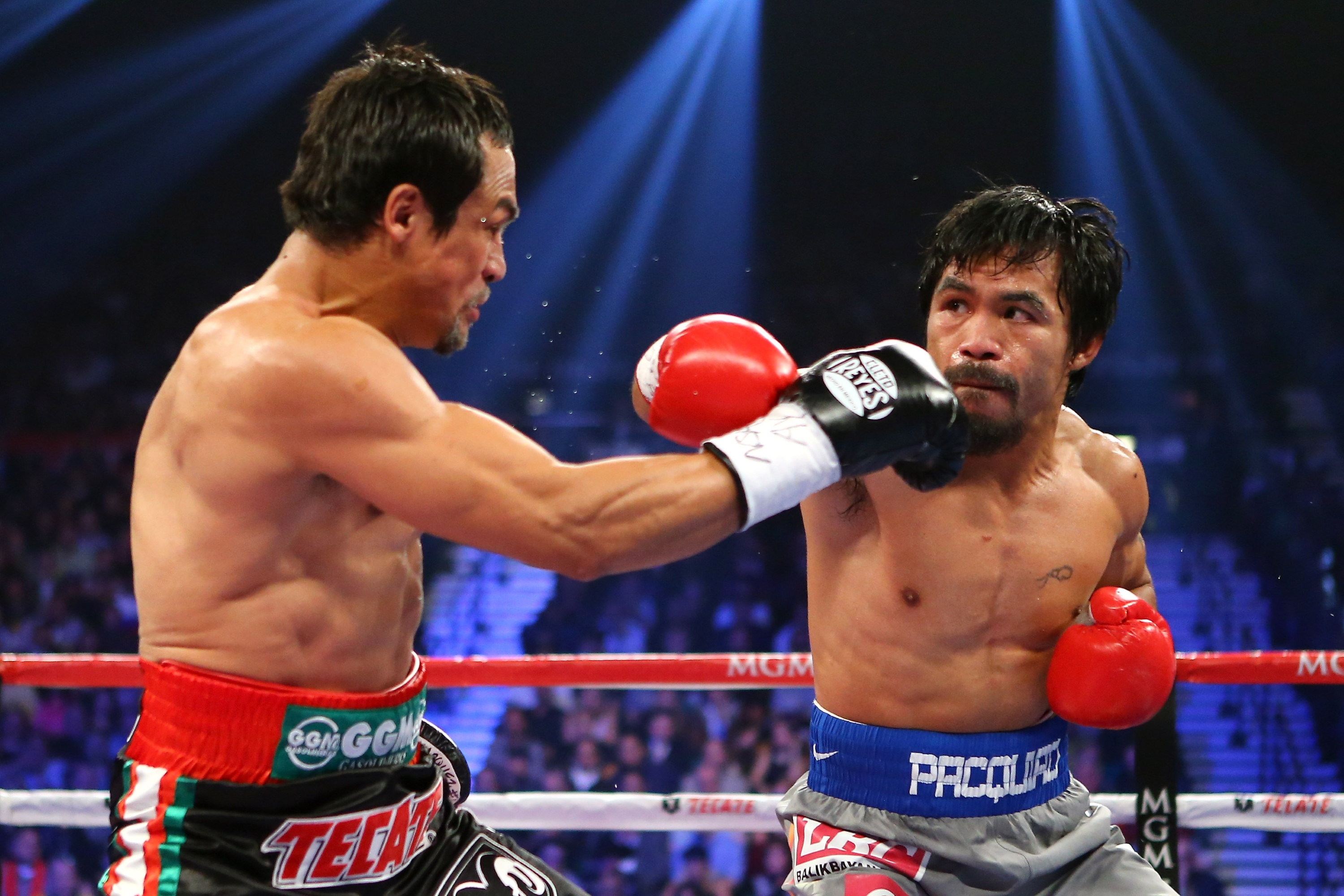 Manny Pacquiao throws a right at Juan Manuel Marquez. (Getty)