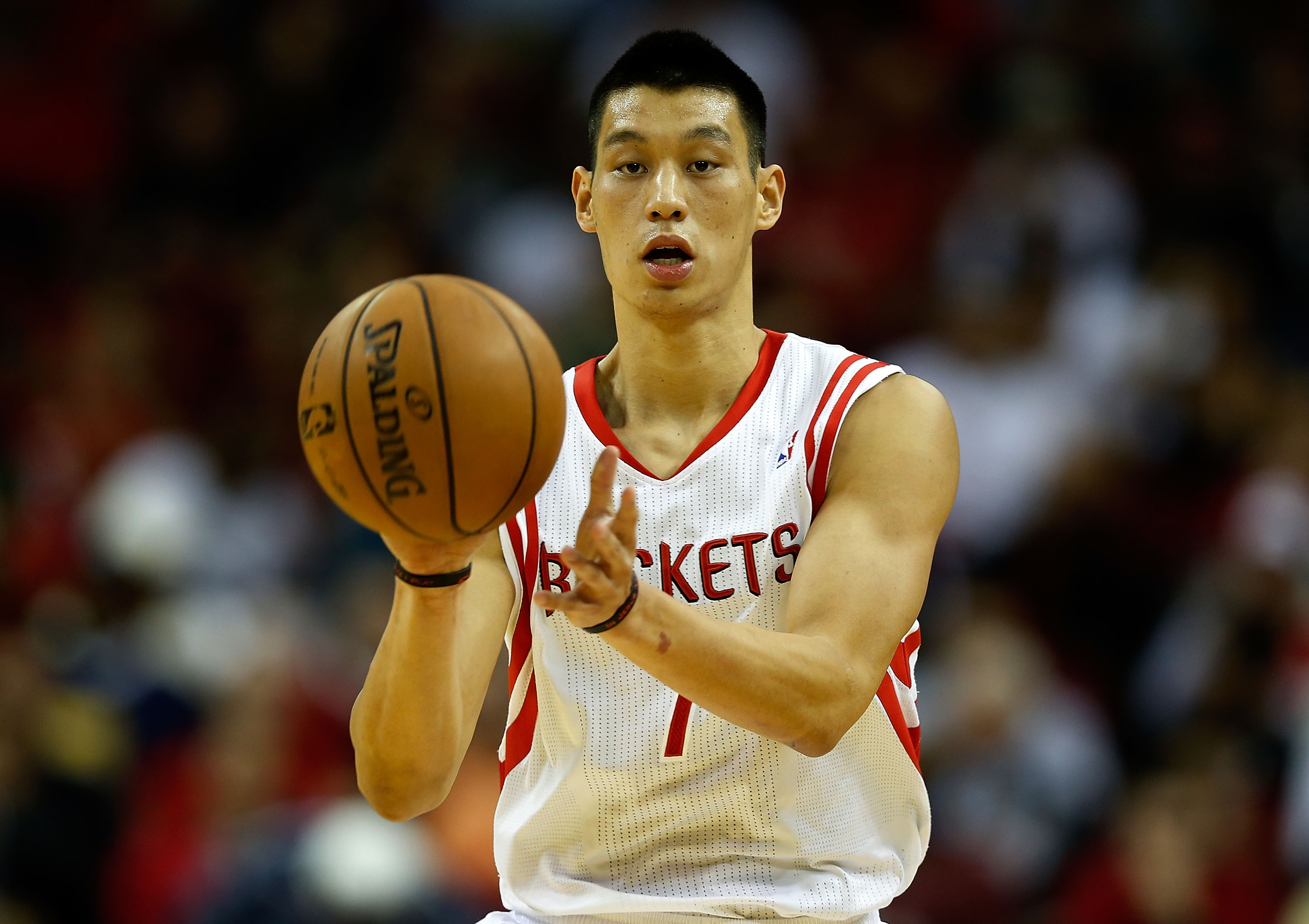 Jeremy Lin received a three-year, $25 million contract from the Rockets. (Getty Images)