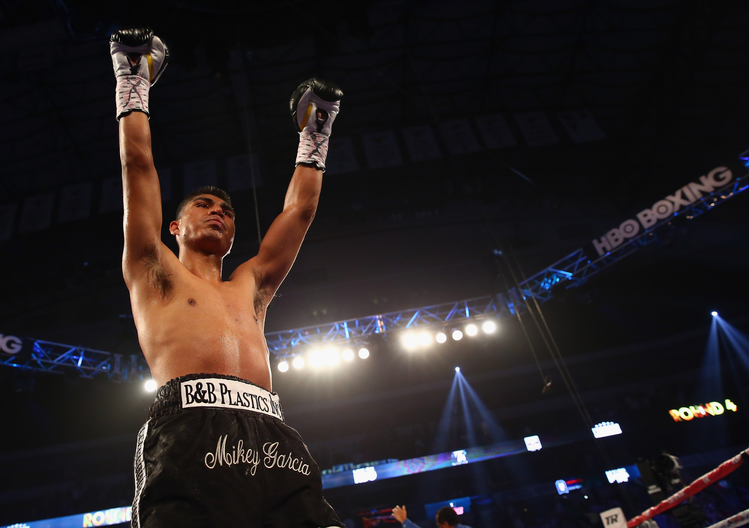 Mikey Garcia celebrates after knocking out Juan Manuel Lopez. (Getty)