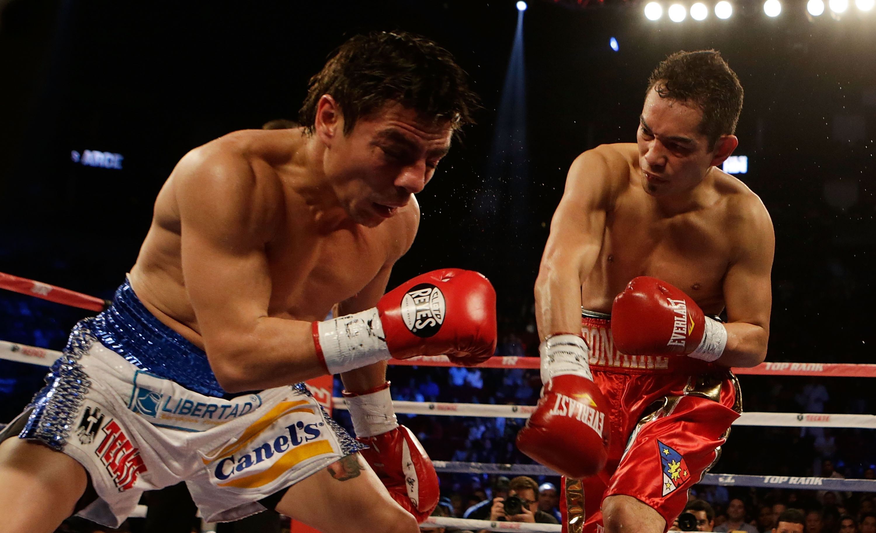 Nonito Donaire Jr. (right), hammering Jorge Arce in his last bout, is no longer consumed by winning. (Getty Images)