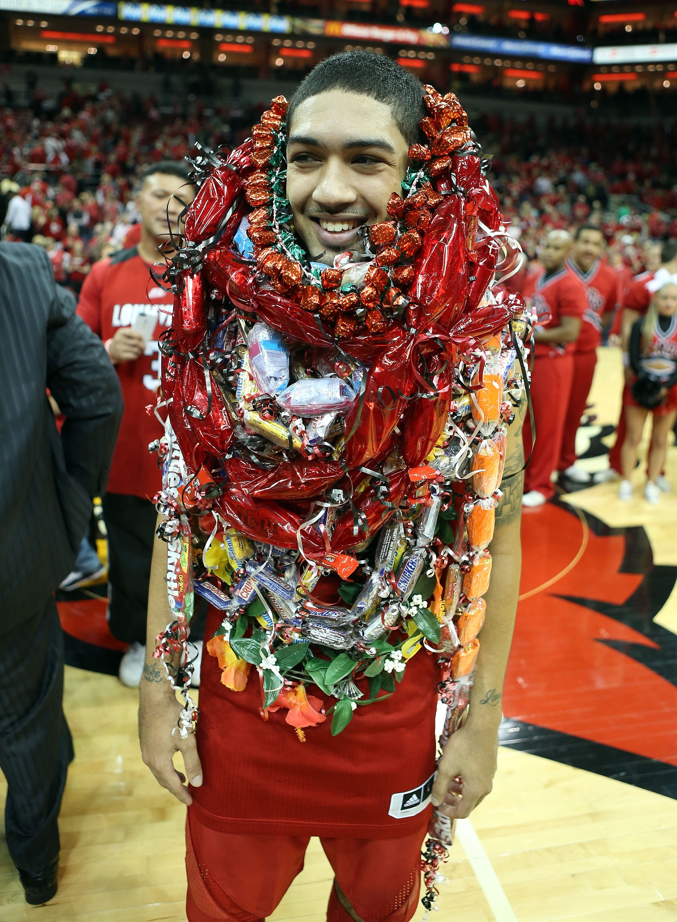 Louisville's Peyton Siva is overwhelmed with leis after the Cardinals' win. (Getty)