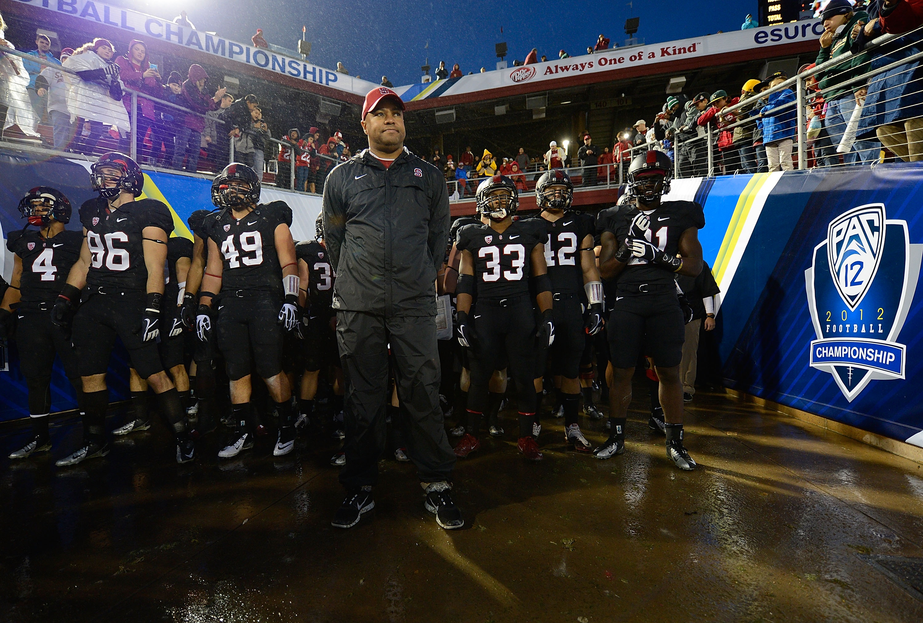 David Shaw stands in front of his team before they take the field to play UCLA. (Getty)