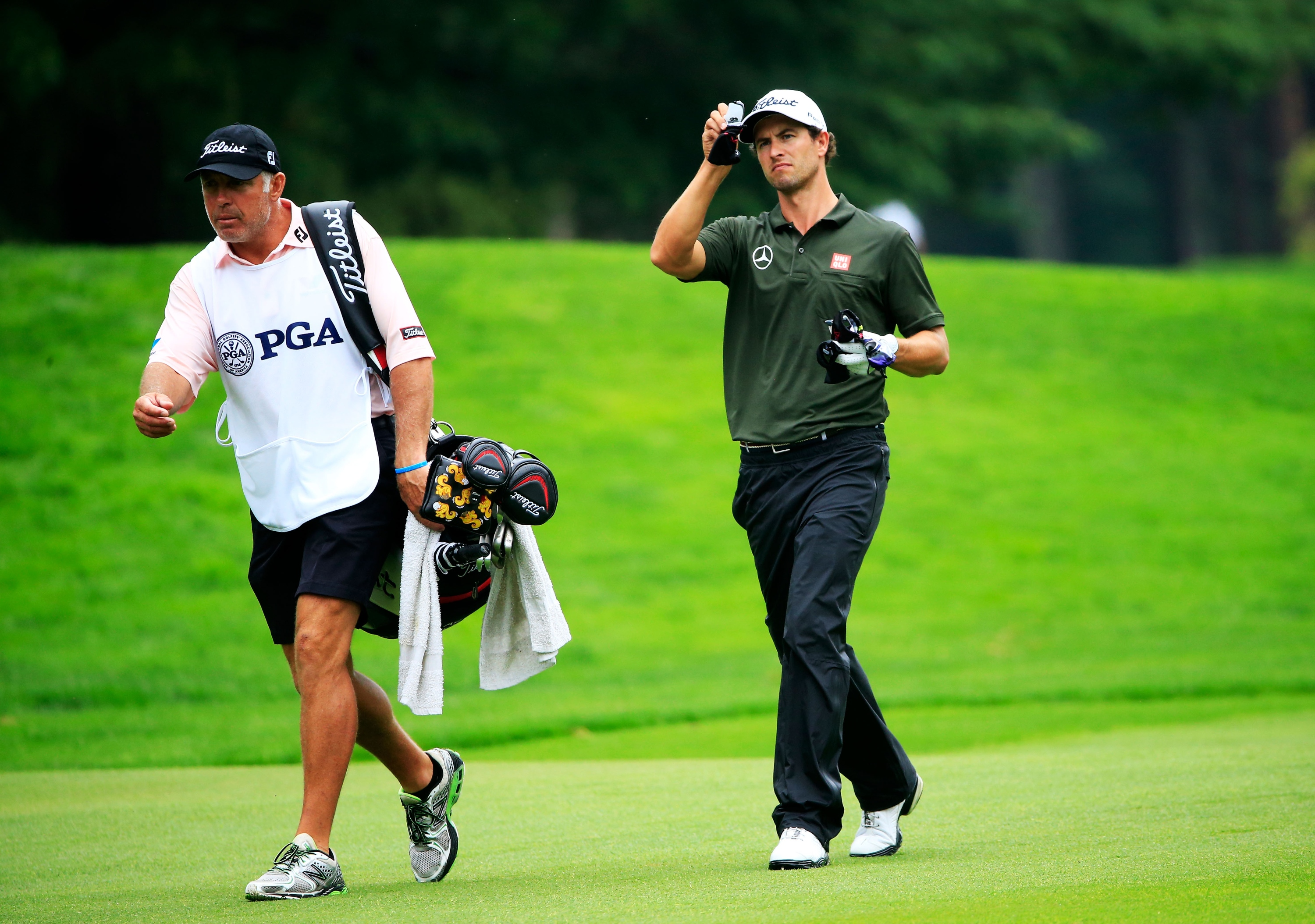 Steve Williams and Adam Scott walk up the 4th fairway during Round 2 of the PGA Championship. (Getty Images
