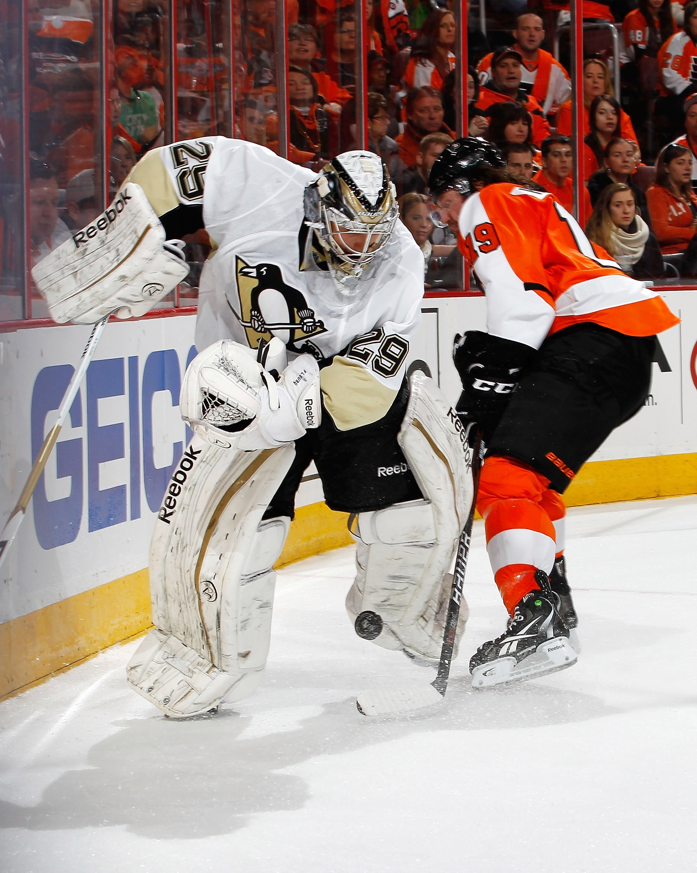 Marc-Andre Fleury tries to clear the puck in front of Scott Hartnell. (Getty Images)