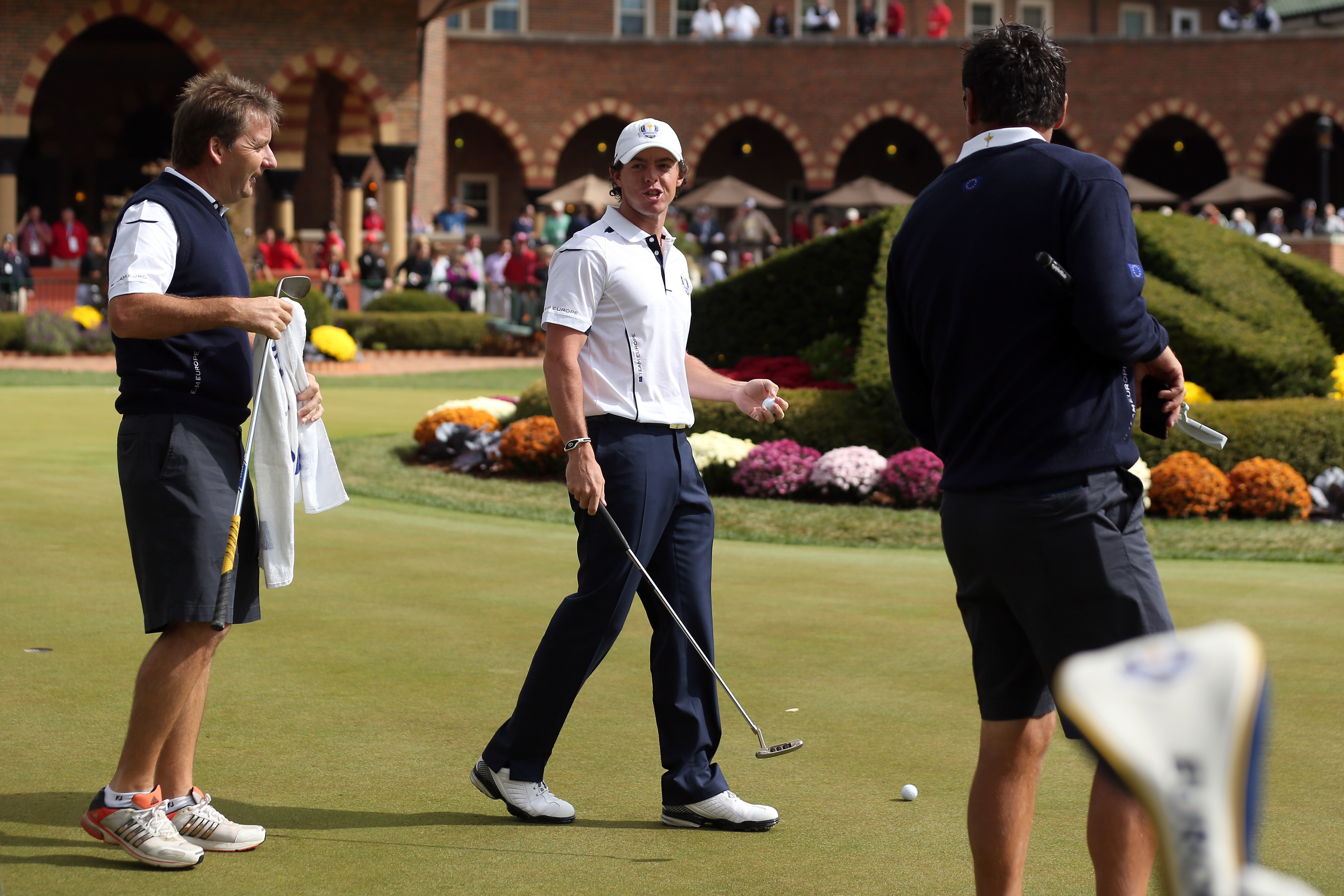 Rory McIlroy waits on the putting green after arriving late to the golf course. (Getty Images)