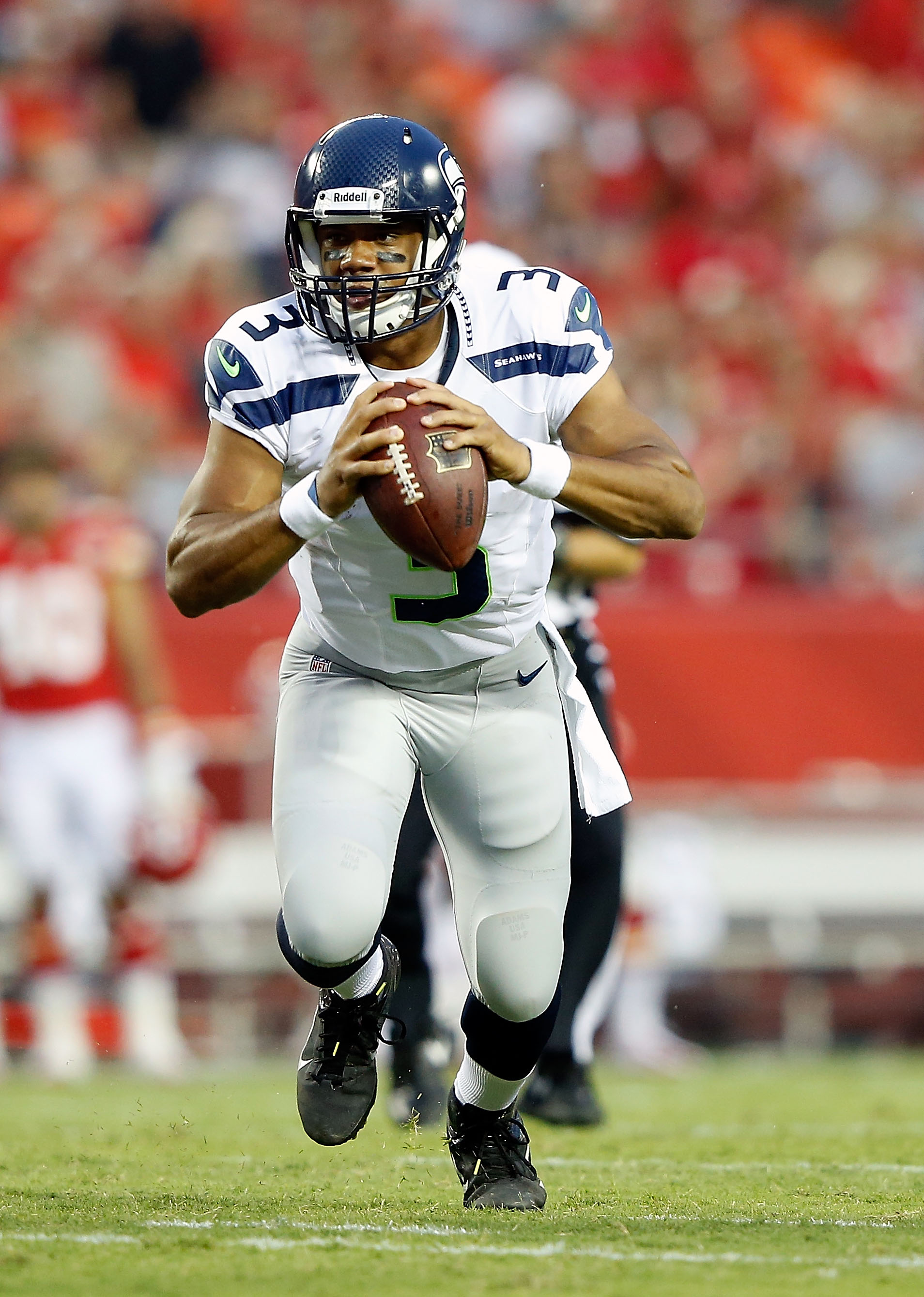 Russell Wilson began to impress the Seahawks' coaching staffs before the draft. (Getty Images)