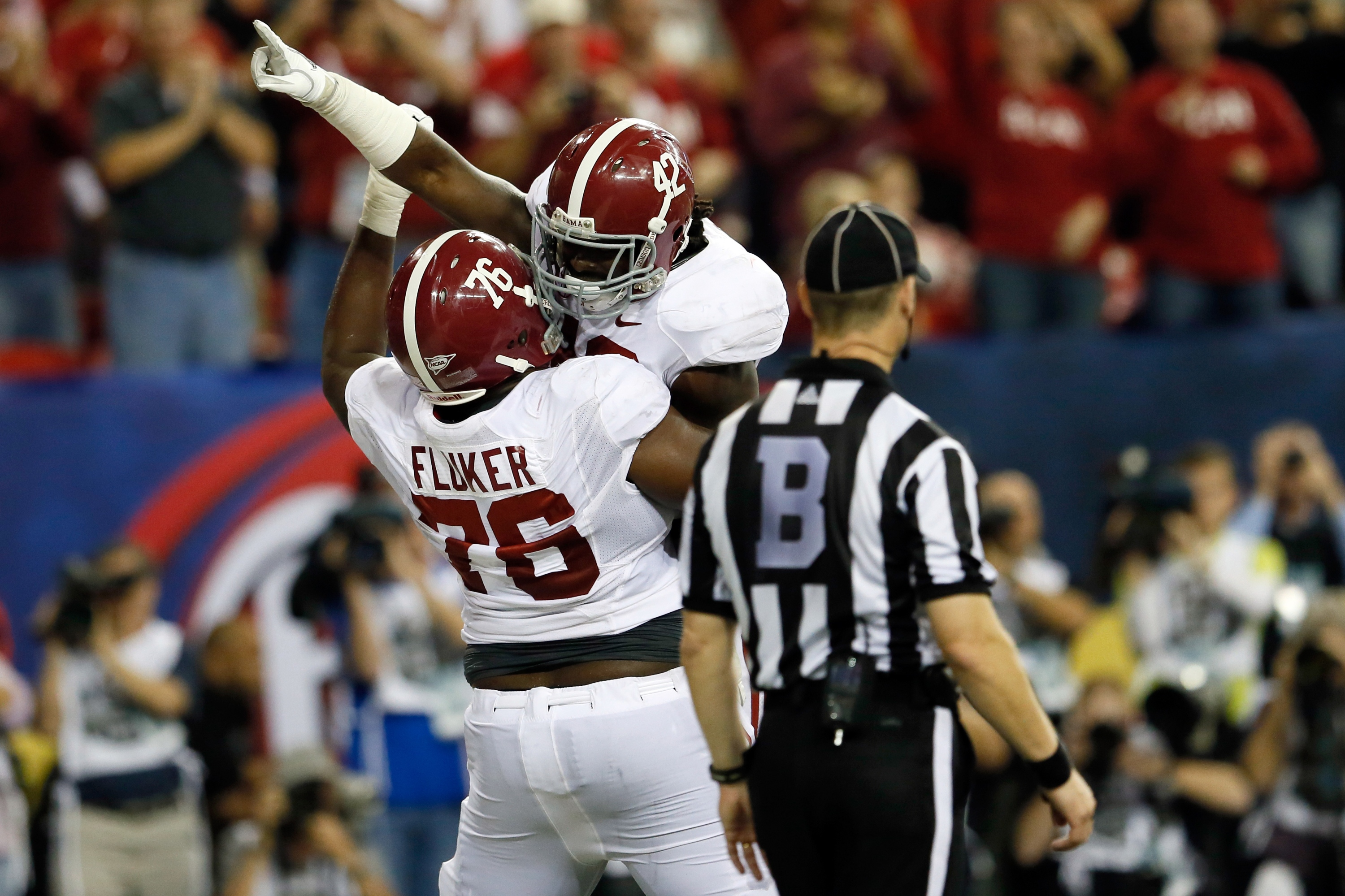 D.J. Fluker hoists up Eddie Lacy after he scored a TD in the BCS title game. (Getty)