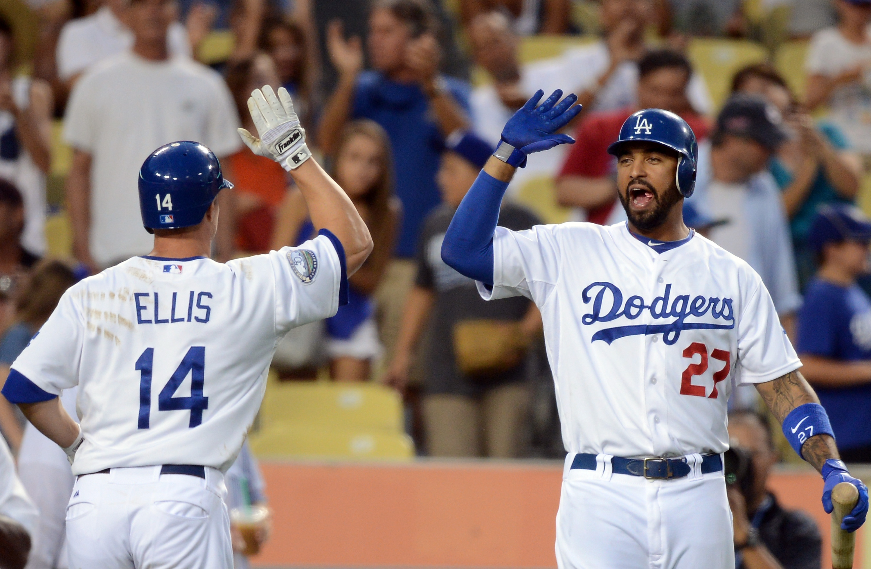 Matt Kemp, right, helped the Dodgers beat the Cardinals with his defense. (Getty Images)